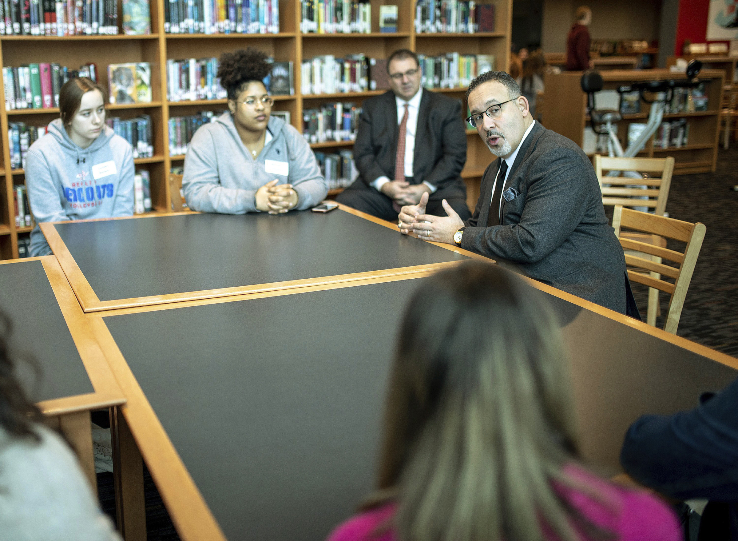 Connecticut Commissioner of Education Miguel Cardona speaks with Berlin High School students while on a tour of the school on Jan. 28, 2020.