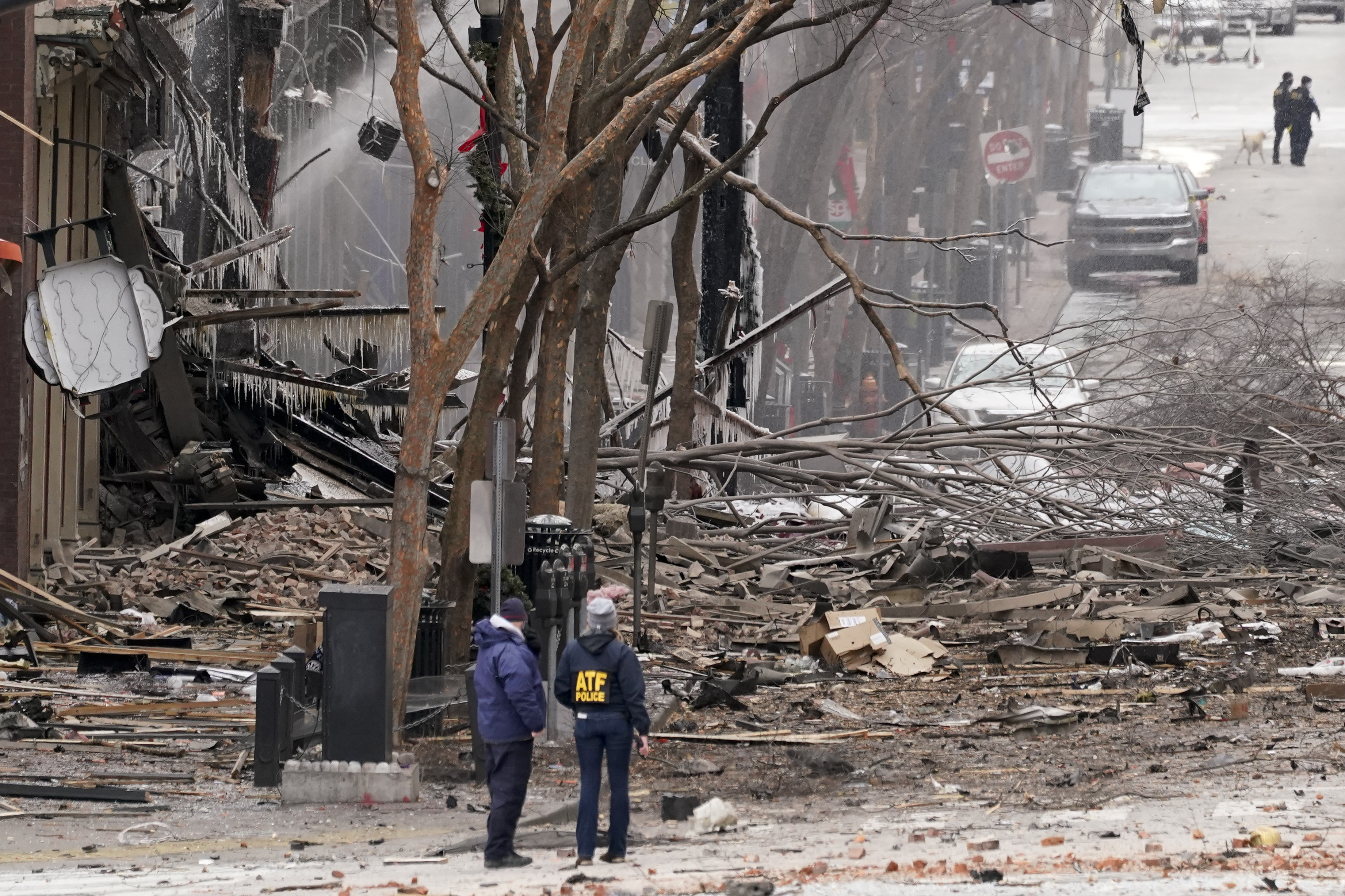 Emergency personnel work near the scene of an explosion in downtown Nashville, Tenn., Friday, Dec. 25, 2020. Buildings shook in the immediate area and beyond after a loud boom was heard early Christmas morning.