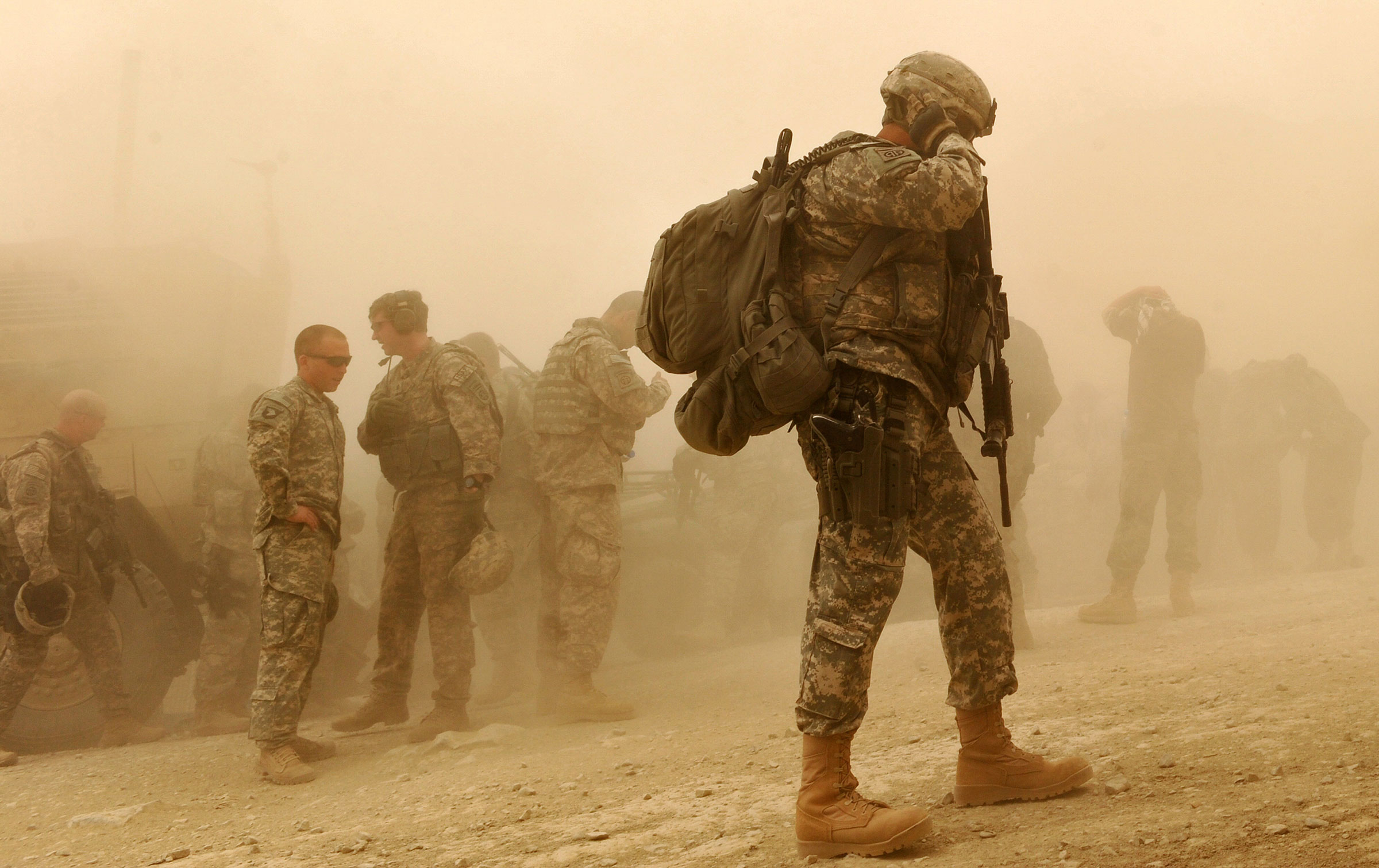US Army soldiers walk at US military Camp Wilderness in Khost province, Afghanistan on April 10, 2010.