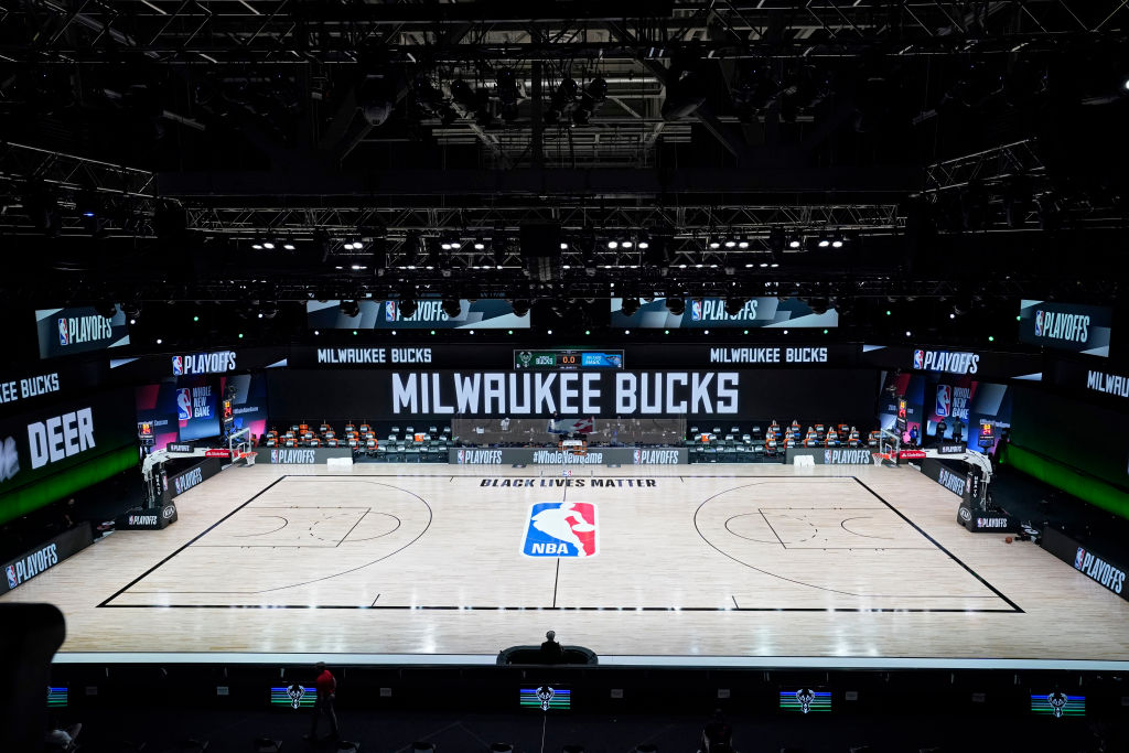 The court and benches are empty after the scheduled start of game five between the Milwaukee Bucks and the Orlando Magic in the first round of the 2020 NBA Playoffs at AdventHealth Arena at ESPN Wide World Of Sports Complex on August 26, 2020 in Lake Buena Vista, Florida.
