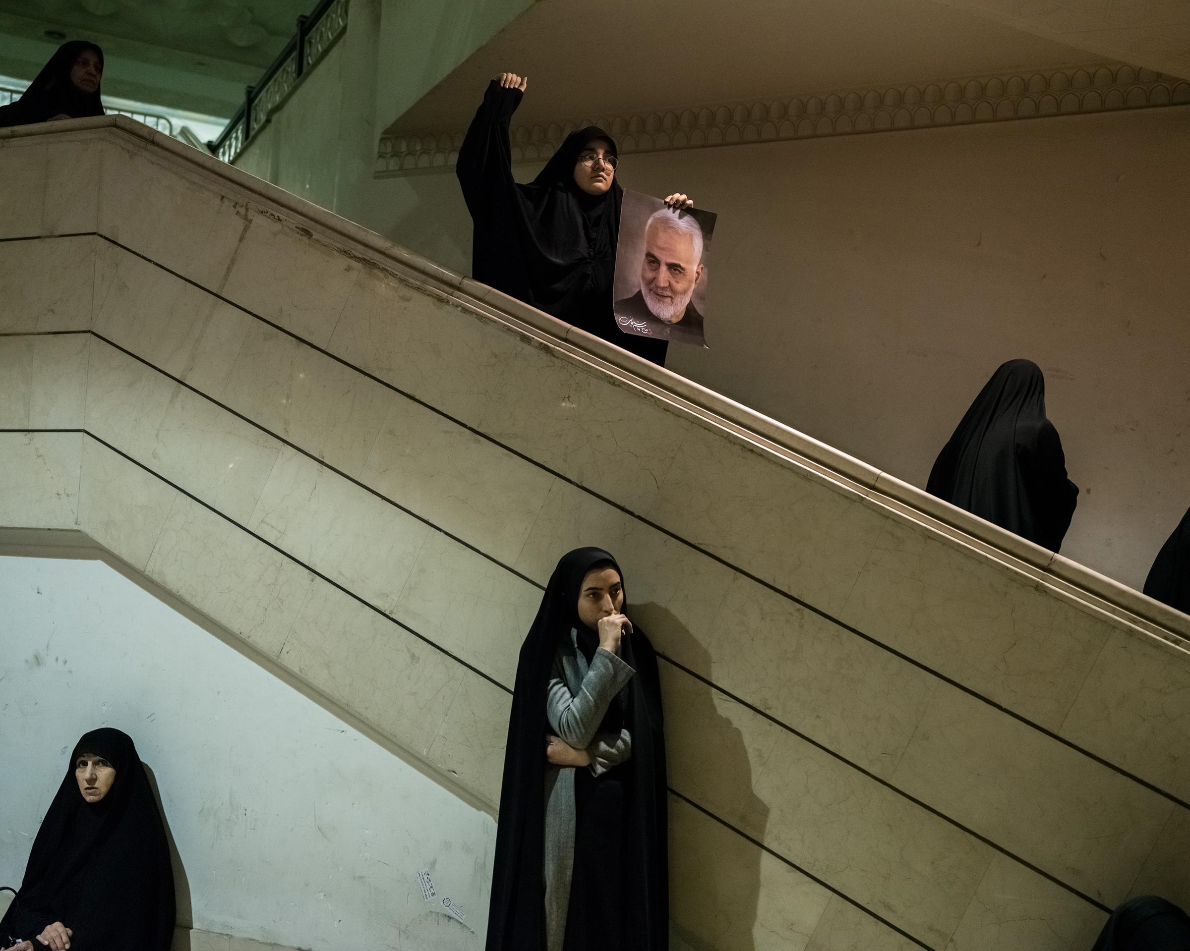 Iranian women at a mosque in Tehran, on Jan. 5, mourn Qasem Soleimani's death.