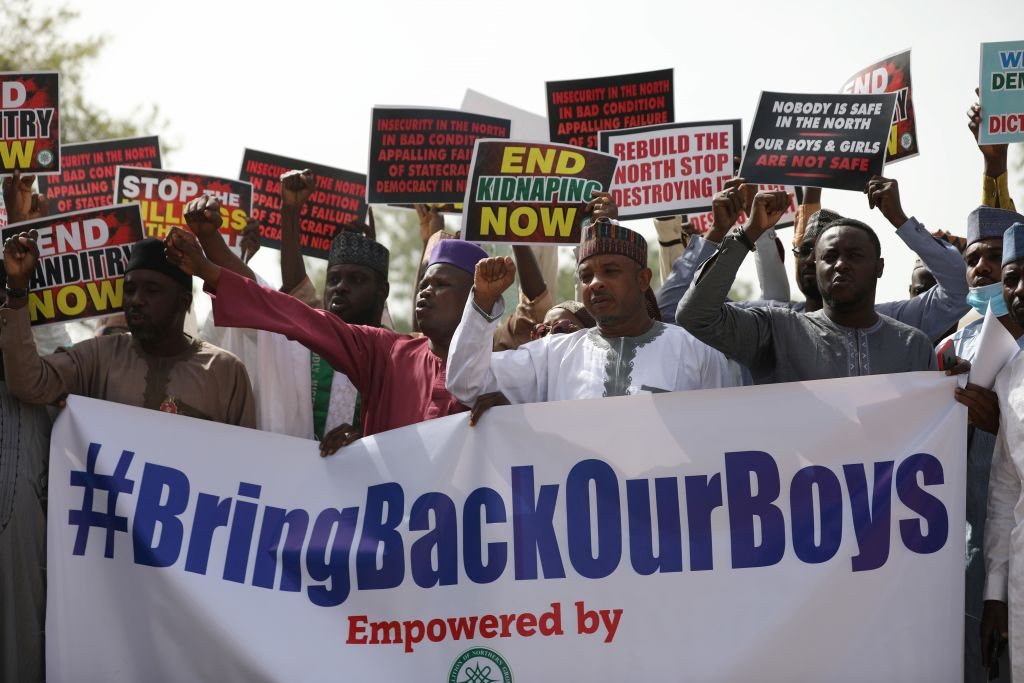 Supporters of the  Coalition of Northern Groups  (CNG) rally to urge authorities to rescue hundreds of abducted schoolboys, in northwestern state of Katsina, Nigeria on December 17, 2020 - Boko Haram recruited three local gangs in northwest Nigeria to kidnap hundreds of schoolboys on its behalf, security and local sources said on December 16, 2020. The attack occurred hundreds of kilometres from Boko Haram's stronghold in northeast Nigeria, where it launched a brutal insurgency a decade ago.