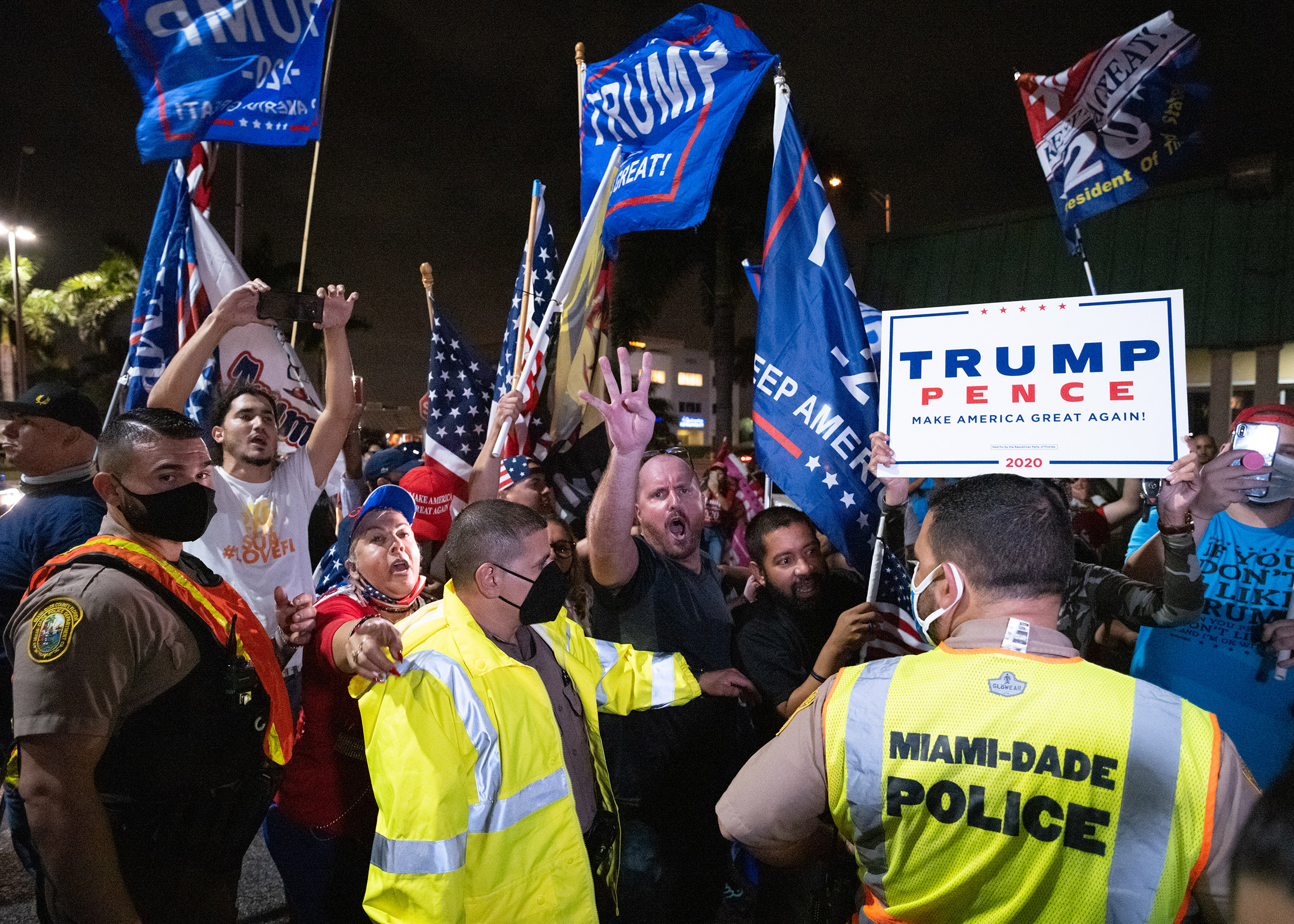 Supporters of President Trump demonstrate, argue with press and become hostile at the Cuban restaurant La Carreta in Miami on Nov. 7.