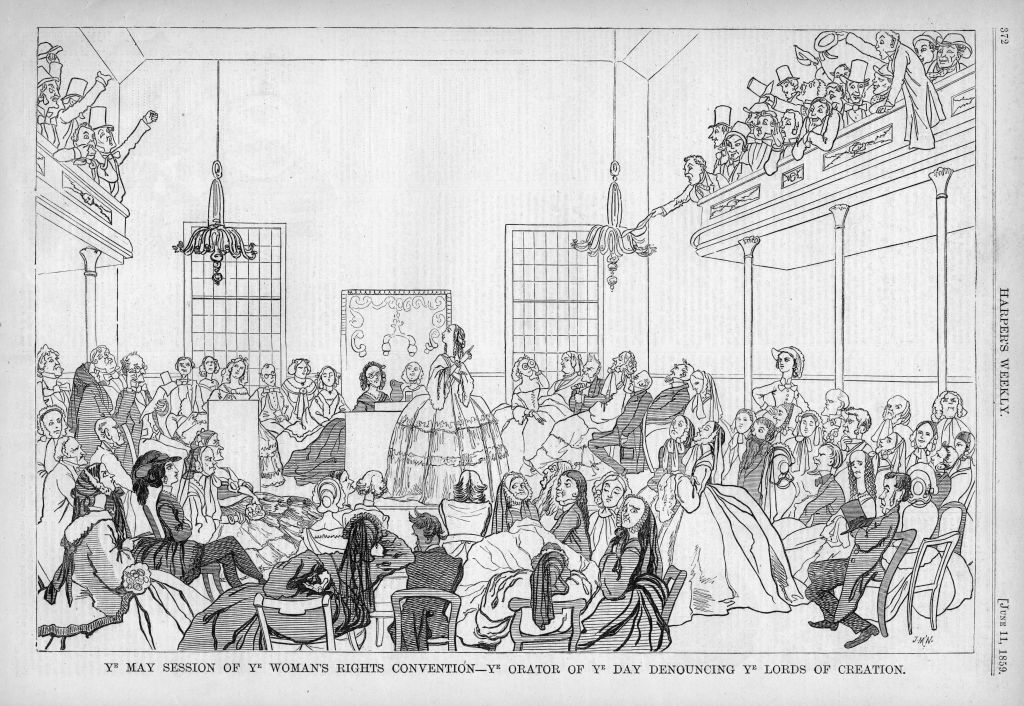 An 1859 Harper's Weekly cartoon parodying the 1848 women's rights convention in Seneca Falls, N.Y., captioned  Ye May Session of Ye Woman's Rights Convention - ye orator of ye day denouncing ye lords of creation,  suggesting that suffrage is contrary to religious and natural law.