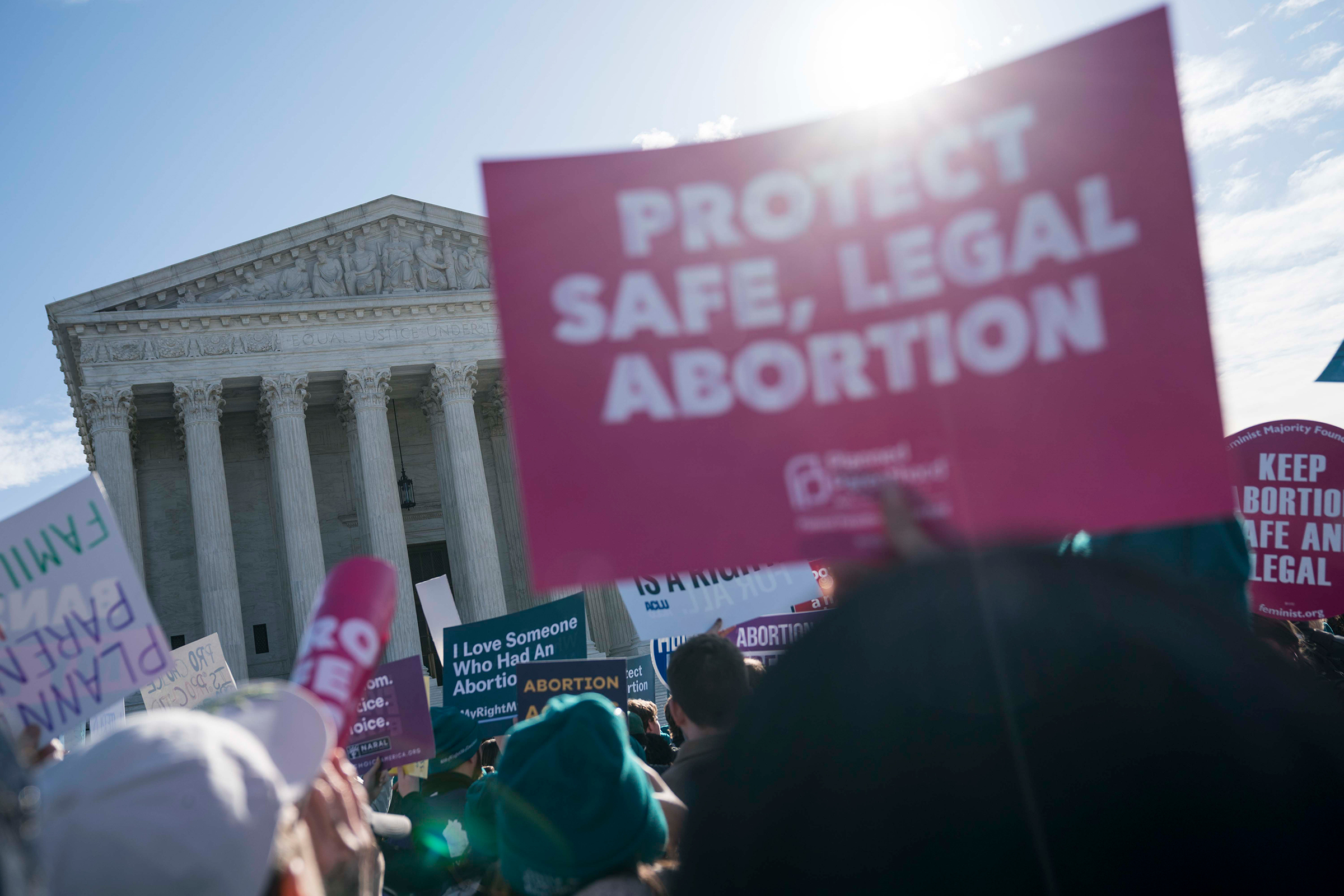 People participate in an abortion rights rally outside of the Supreme Court on March 4