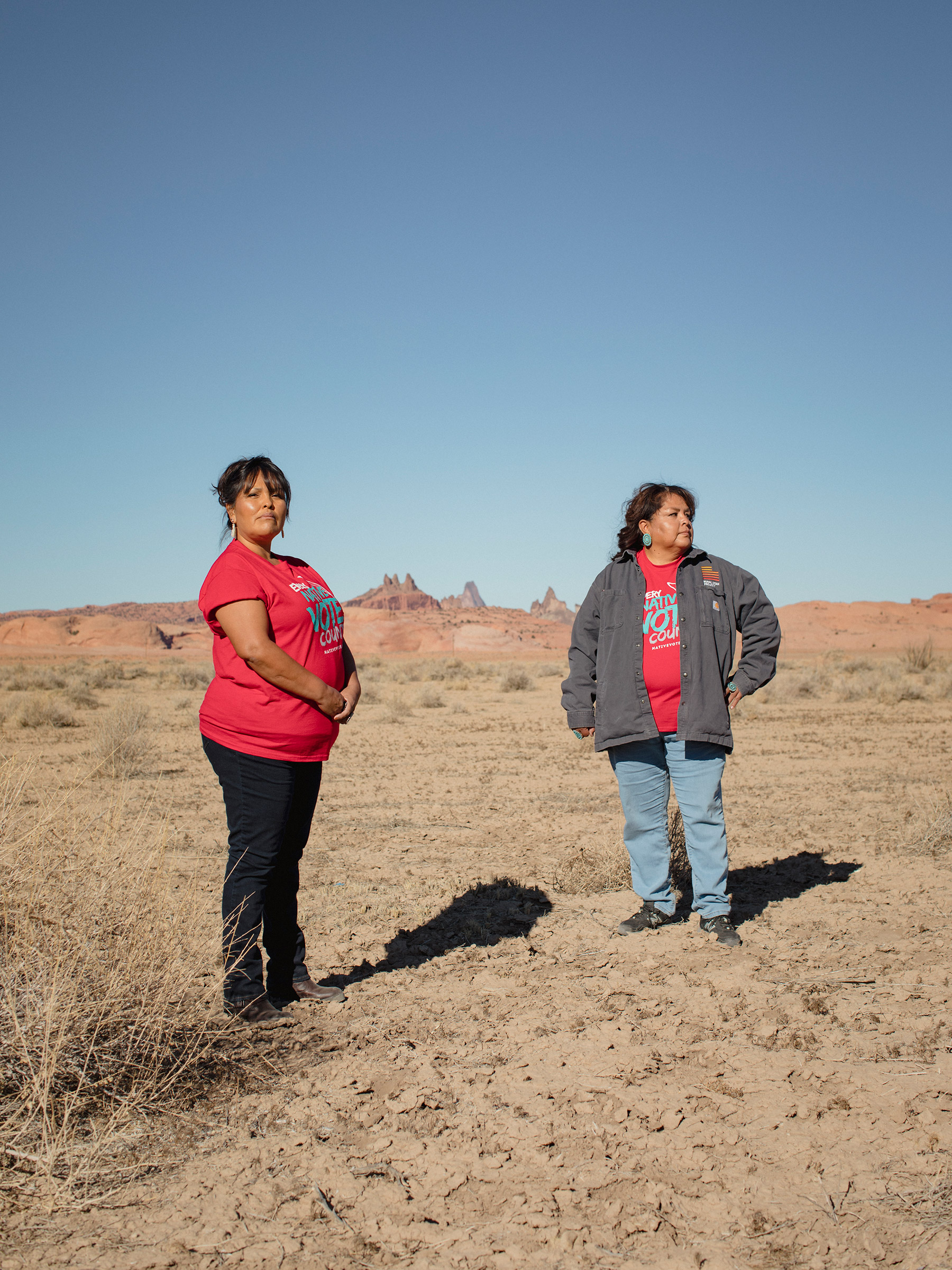 (L-R) Tara Benally and Dalene Redhorse pose for a portrait in front of Church Rock in Navajo County, Arizona on December 4, 2020. CREDIT: Adria Malcolm for TIME Magazine
