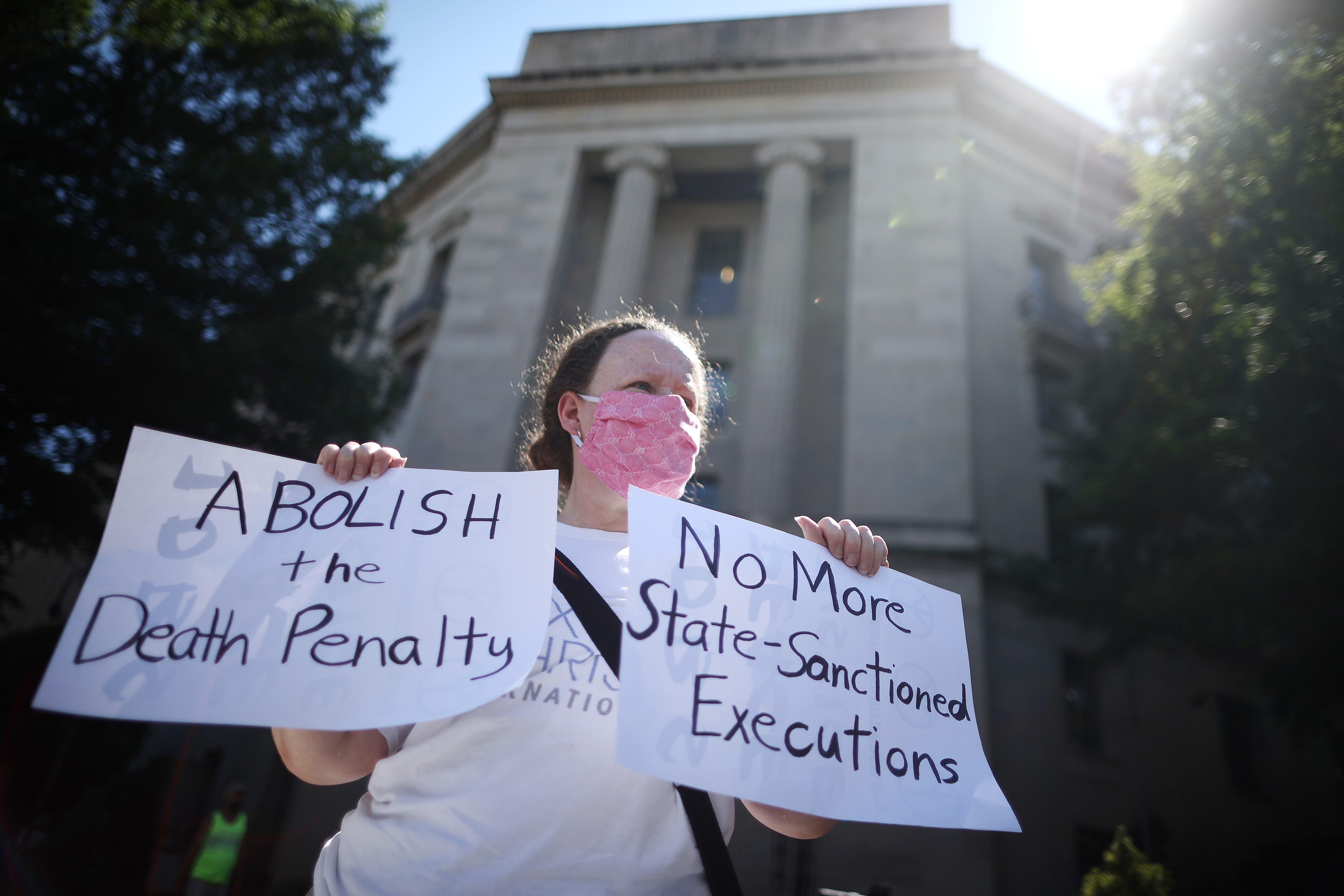 Anti-death penalty activist Judy Coode demonstrates in front of the U.S. Justice Department on July 13, 2020 in Washington, D.C.