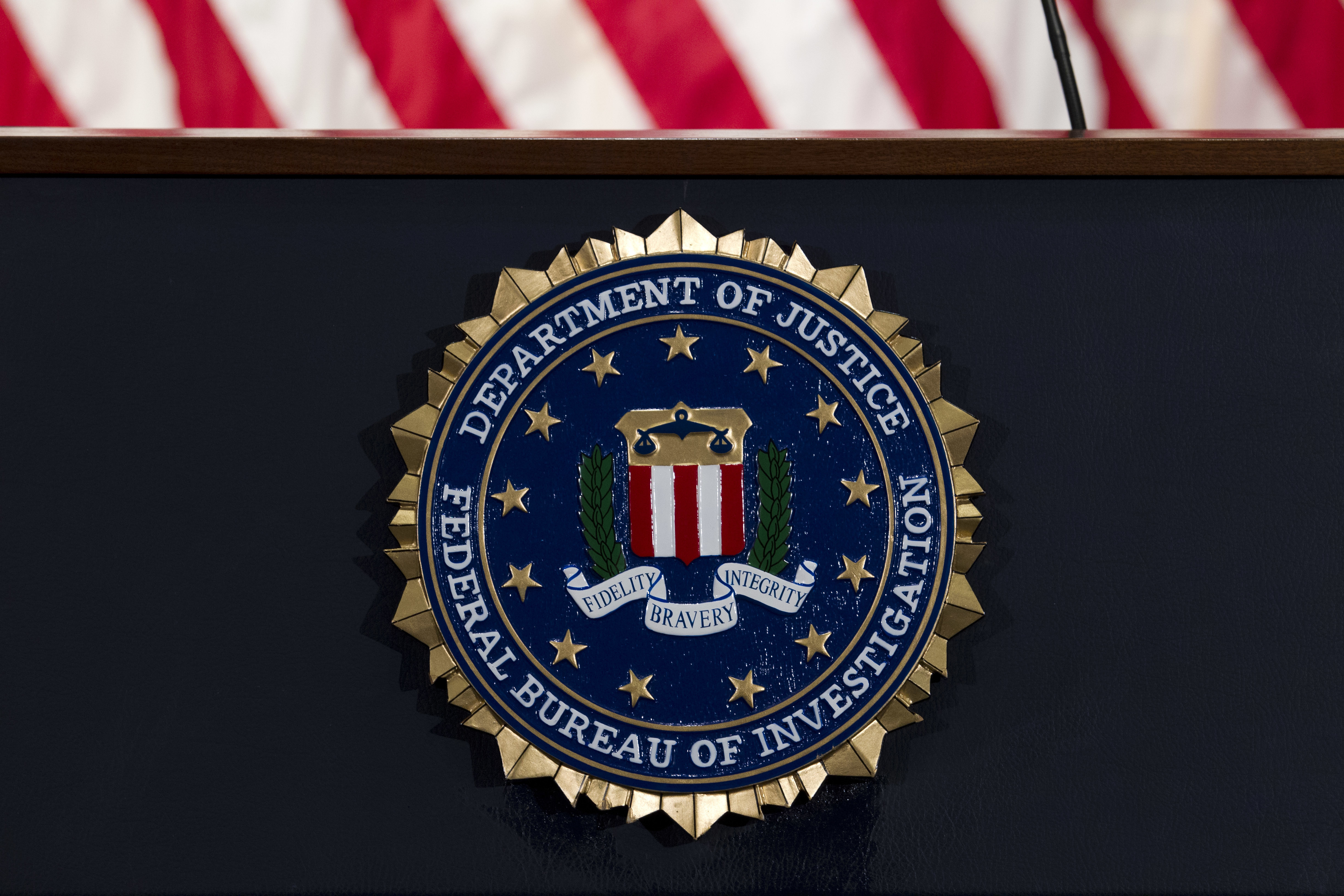 In this June 14, 2018, file photo, the FBI seal is seen before a news conference at FBI headquarters in Washington.
