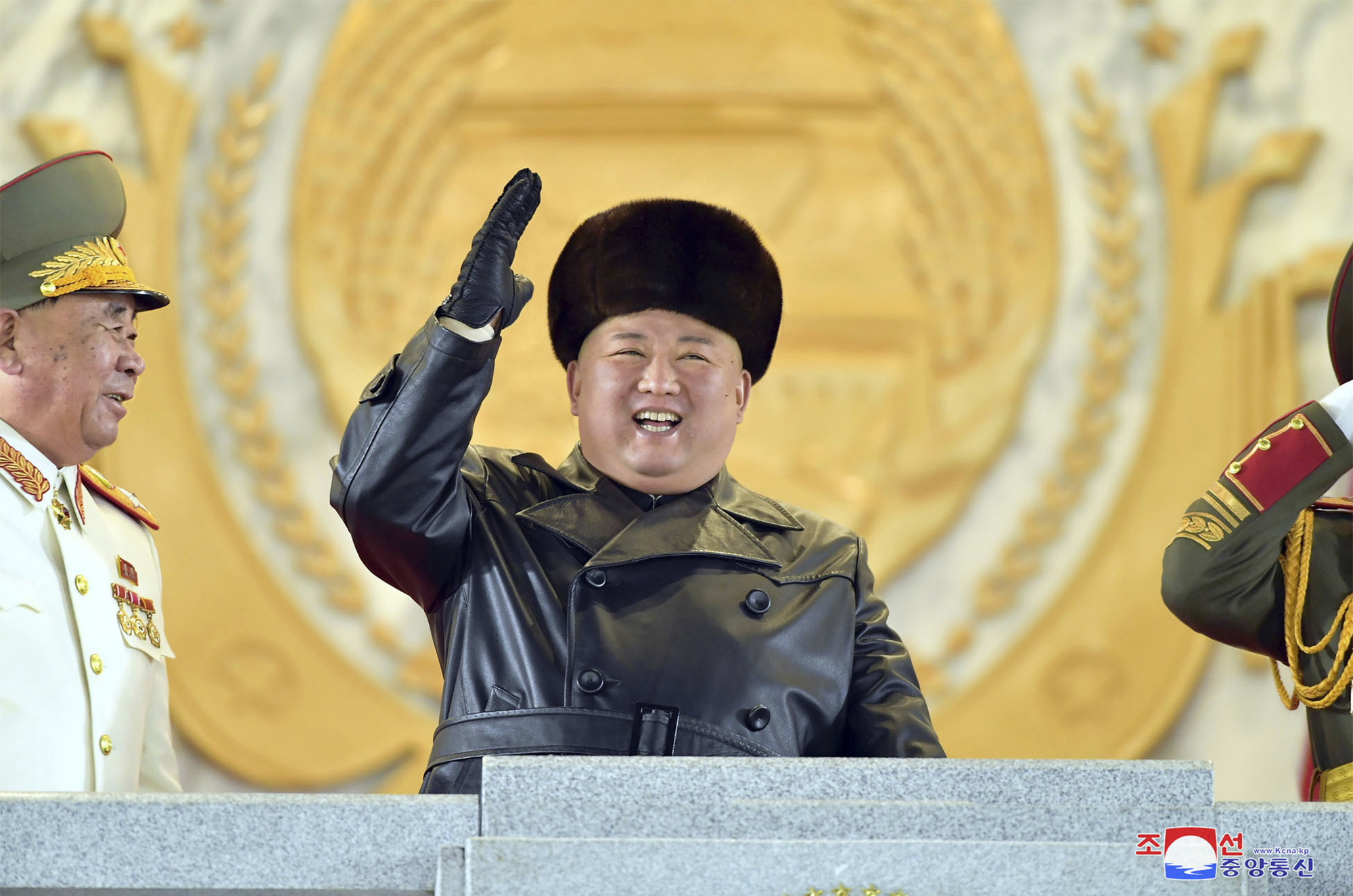 In this photo provided by the North Korean government, North Korean leader Kim Jong Un waves while attending a military parade, marking the ruling party congress, at Kim Il Sung Square in Pyongyang, North Korea Thursday, Jan. 14, 2021.