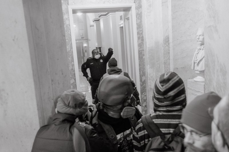 A Capitol Police officer is pushed back as he attempts to stop pro-Trump rioters from entering further into the Capitol building.