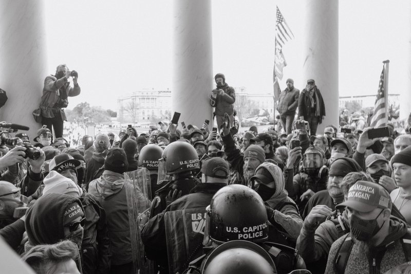 Capitol police move through the crowd of Trump supporters outside of the Capitol.