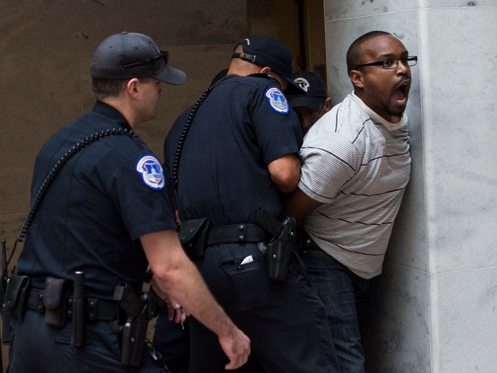 US Capitol Police arrest a protestor as Judge Brett Kavanaugh testifies during the second day of his US Senate Judiciary Committee confirmation hearing to be an Associate Justice on the US Supreme Court, on Capitol Hill in Washington, DC, September 5, 2018.