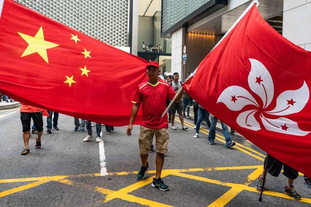 Pro-China supporters wave Chinese and Hong Kong flags as they attempt to hold a march in a shopping mall but were met with large numbers of pro-democracy supporters in Hong Kong, China on Sept. 18, 2019.