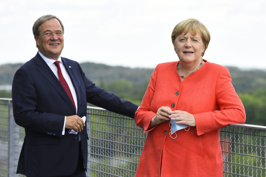 German Chancellor Angela Merkel and North Rhine-Westphalia Governor Armin Laschet visit the Ruhr Conference at the Zeche Zollverein former coal mine and coking plant on Aug. 18, 2020 in Essen, Germany.
