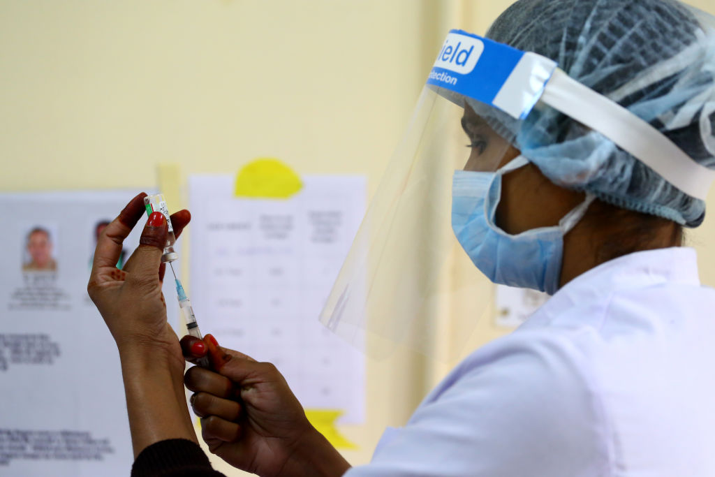A medical worker inoculates a doctor with a COVID-19 coronavirus vaccine at the J.L.N Hospital in Ajmer, Rajasthan, India on 18 January 2021.