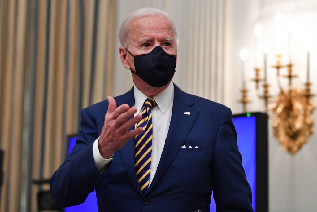 US President Joe Biden speaks about the Covid-19 response before signing executive orders for economic relief to Covid-hit families and businesses in the State Dining Room of the White House in Washington, DC, on January 22, 2021.