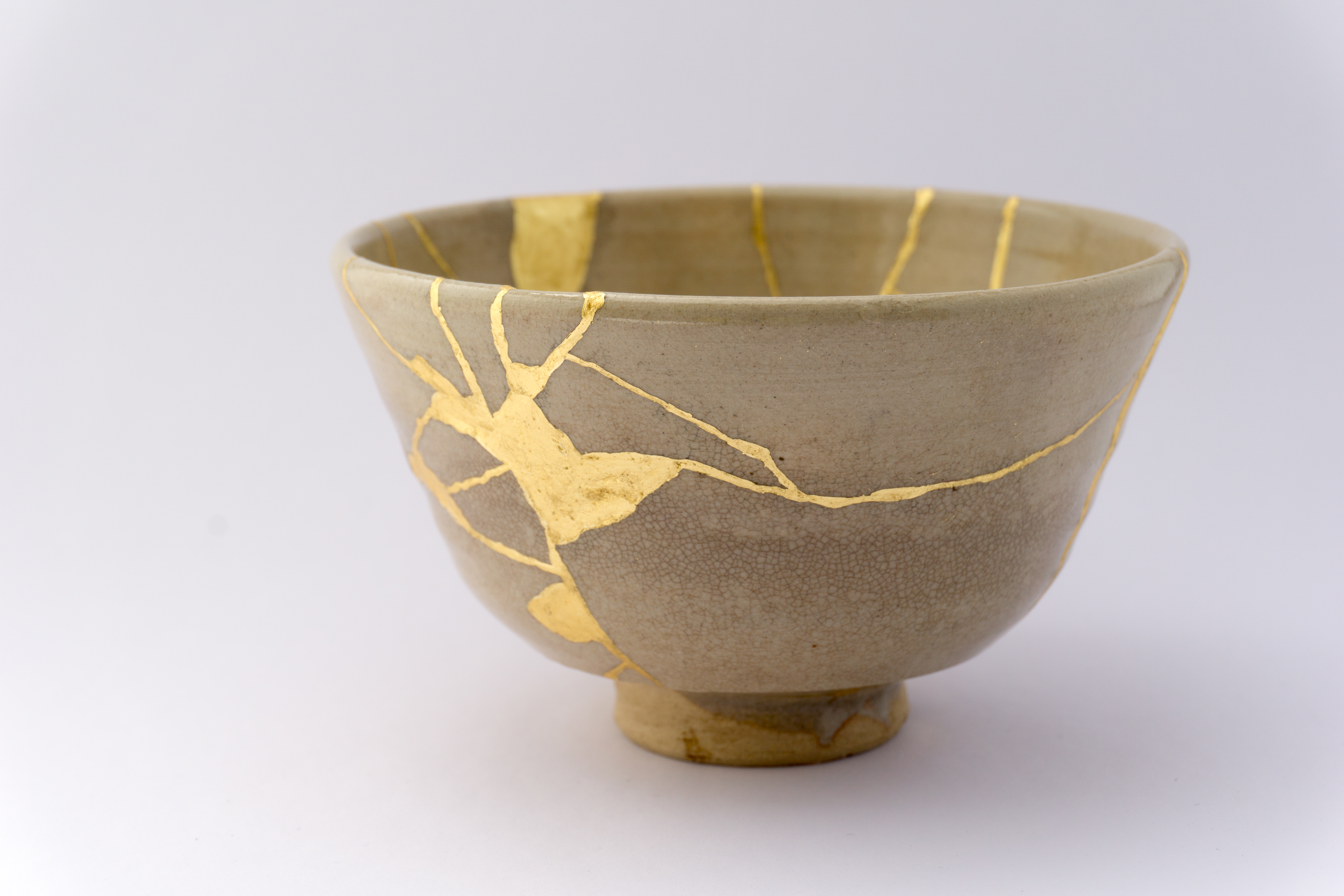 Old Japanese pottery restored with the antique Kintsugi restoration technique.