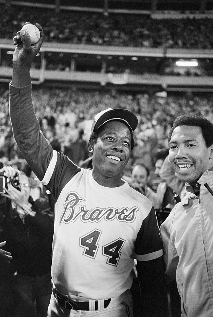 Hank Aaron holds up the ball that broke Babe Ruth's home run record in Atlanta, Ga., on April 8, 1974.