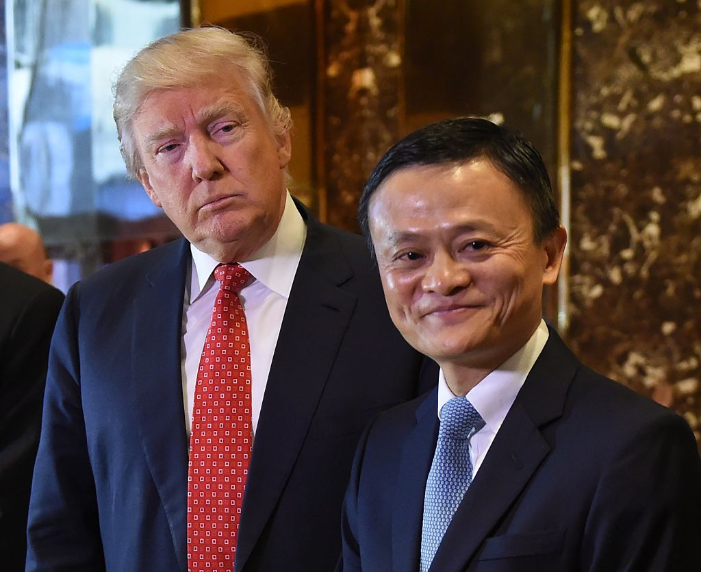 Jack Ma (R), founder and executive chairman of Alibaba Group, and then President-elect Donald Trump pose for the media after their meeting at Trump Tower January 9, 2017.