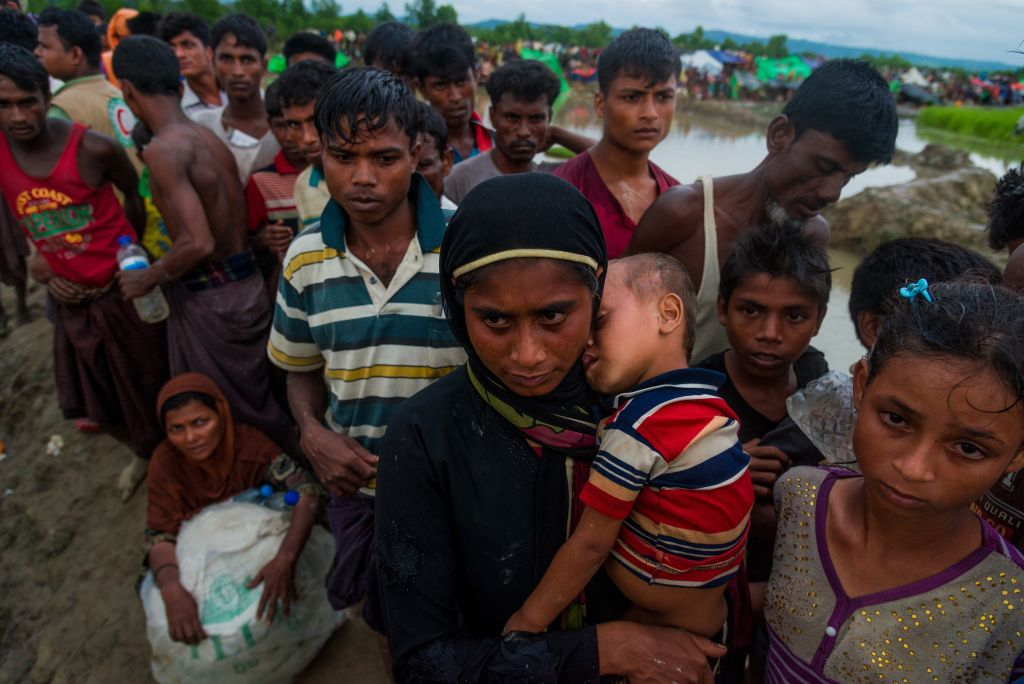 A large group of Rohingya people, fled from ongoing military operations in Myanmar's Rakhine state, try to cross the border at Palongkhalii, Cox's Bazar, Bangladesh, on October 17, 2017.