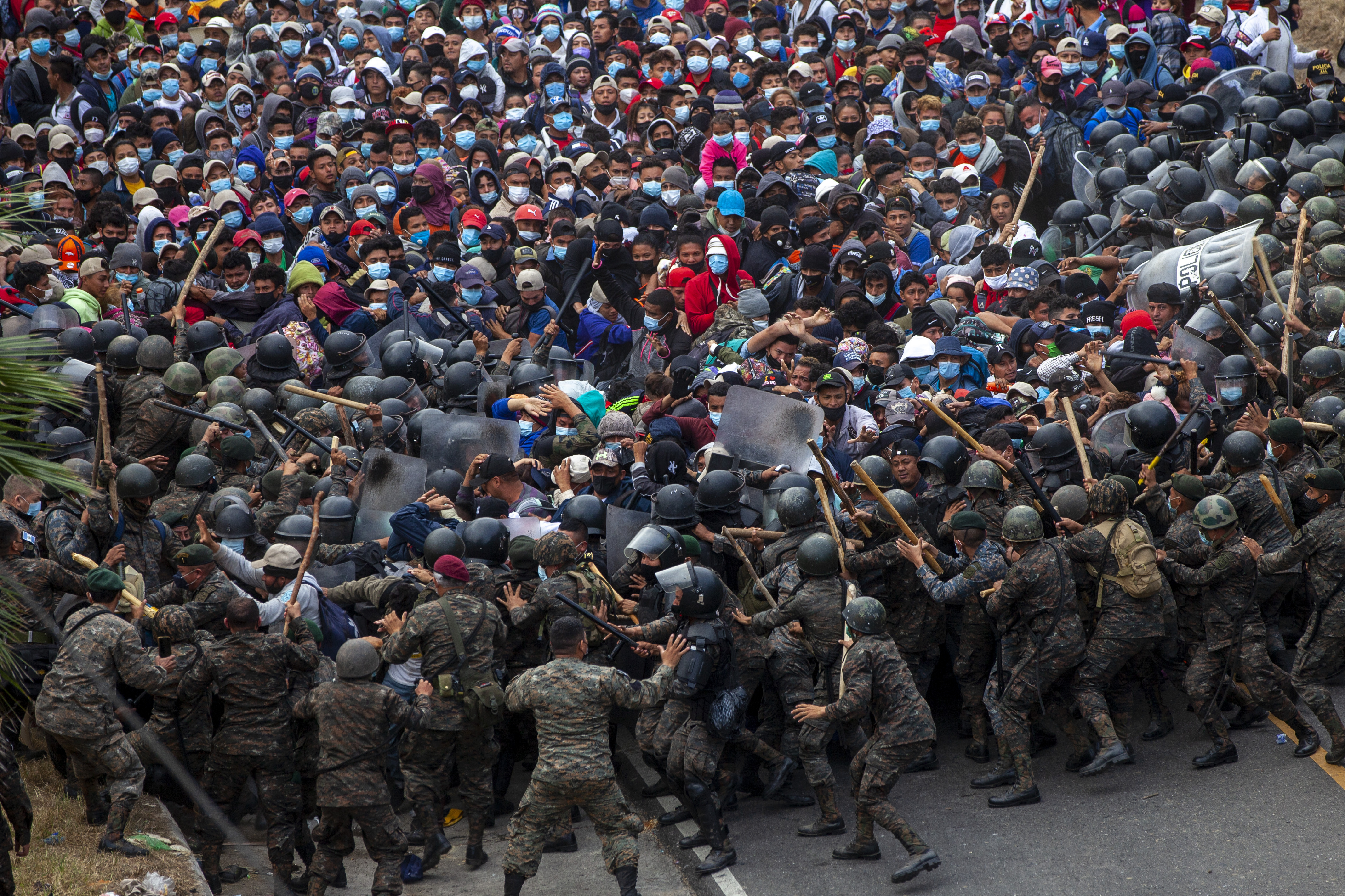 Honduran migrants clash with Guatemalan soldiers in Vado Hondo, Guatemala, Sunday, Jan. 17, 2021. Guatemalan authorities estimated that as many as 9,000 Honduran migrants crossed into Guatemala as part of an effort to form a new caravan to reach the U.S. border.