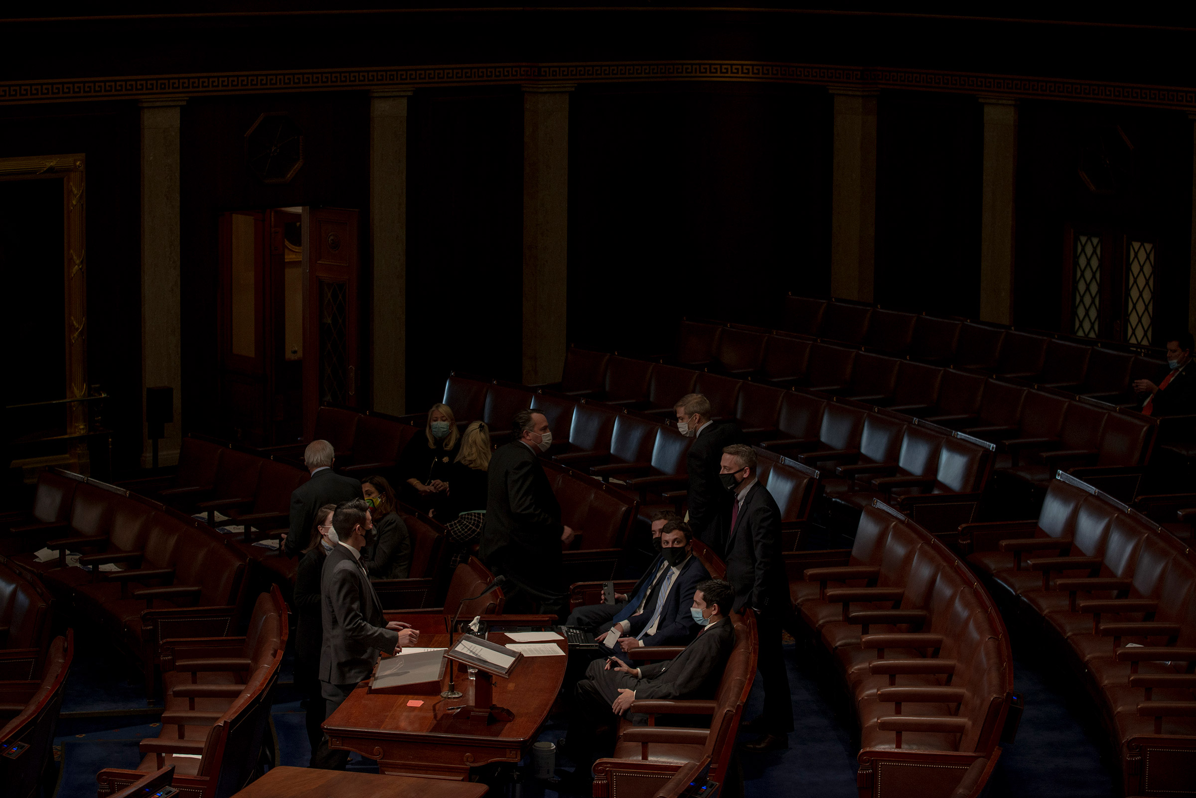 House Republicans huddle during the vote to impeach Trump on Jan. 13.
