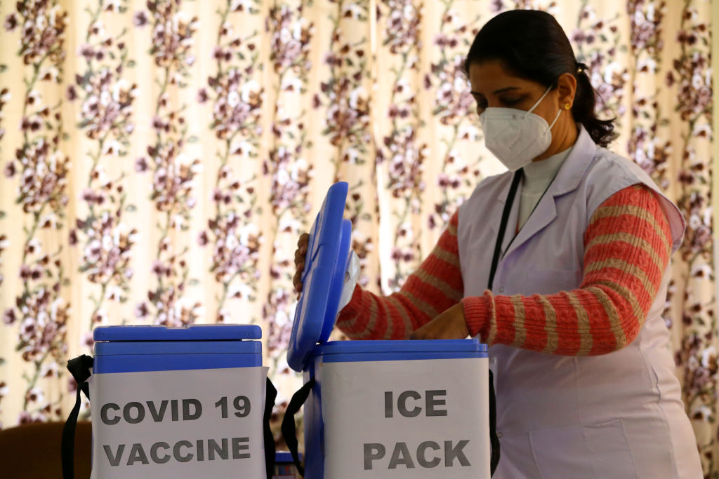 A Health official takes part in dry run or a mock drill for Covid-19 coronavirus vaccine at a Urban Community Health Centre in Ajmer, Rajasthan, India, on Jan. 2, 2021.