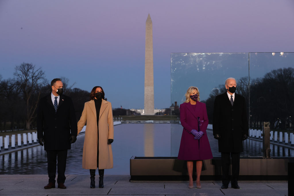 Douglas Emhoff, Kamala Harris, Jill Biden and Joe Biden attended a memorial service to honor the nearly 400,000 American victims of the coronavirus pandemic at the Lincoln Memorial Reflecting Pool on Jan. 19, 2021 in Washington, D.C.