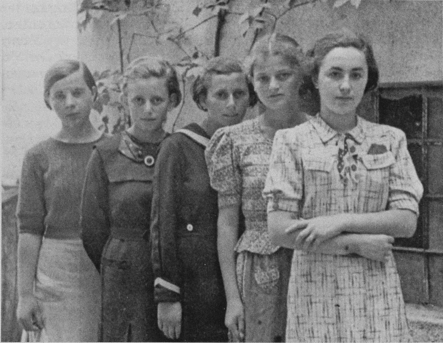 A group of teenage girls from the town of Humenné, Slovakia, c. 1936. From left to right: an unidentified girl, Anna Herskovicova, another unidentified girl, Lea Friedman and Debora Gross (sister of Adela Gross). Adela Gross and Lea Friedman were two of the 999 unmarried Jewish women and girls on the first official transport of Jews to Auschwitz.