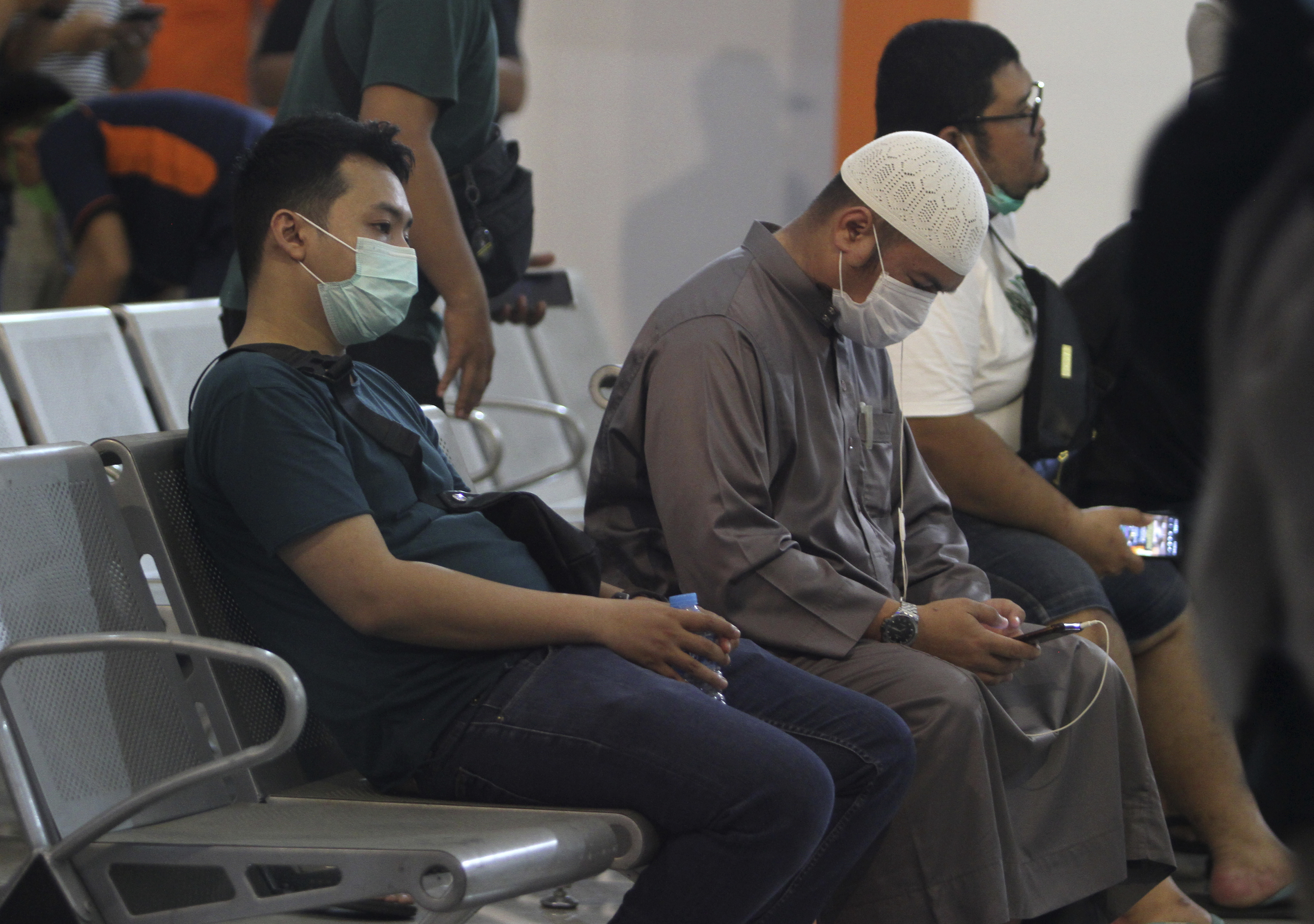 People wait for news on their relatives who are on board of Sriwijaya Air passenger jet that lost contact with air traffic controllers after take off, at Soepadio International Airport in Pontianak, West Kalimantan, Indonesia, on  Jan. 9, 2021.