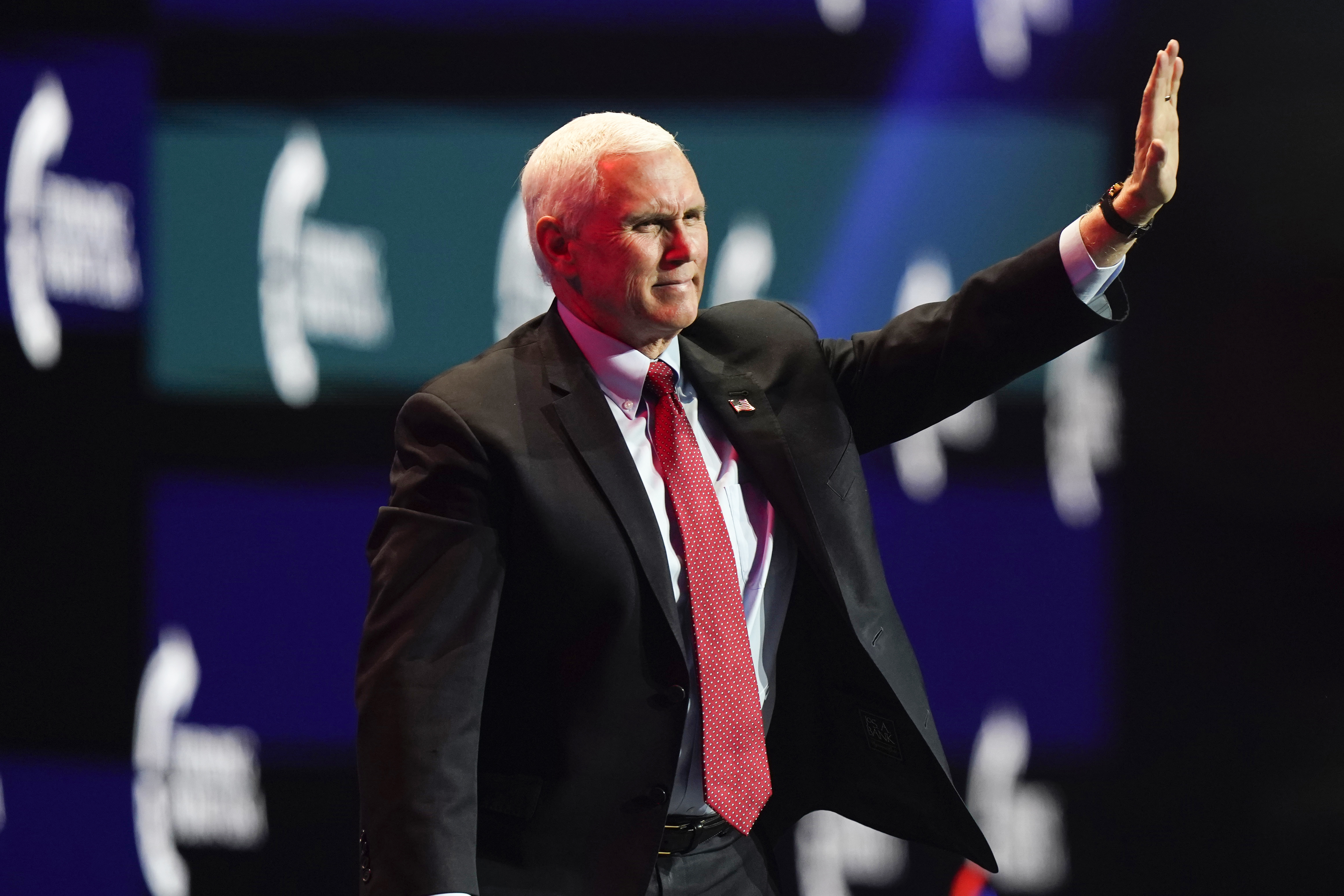 Vice President Mike Pence waves as he walks off the stage after speaking at the Turning Point USA Student Action Summit, Tuesday, Dec. 22, 2020, in West Palm Beach, Fla.