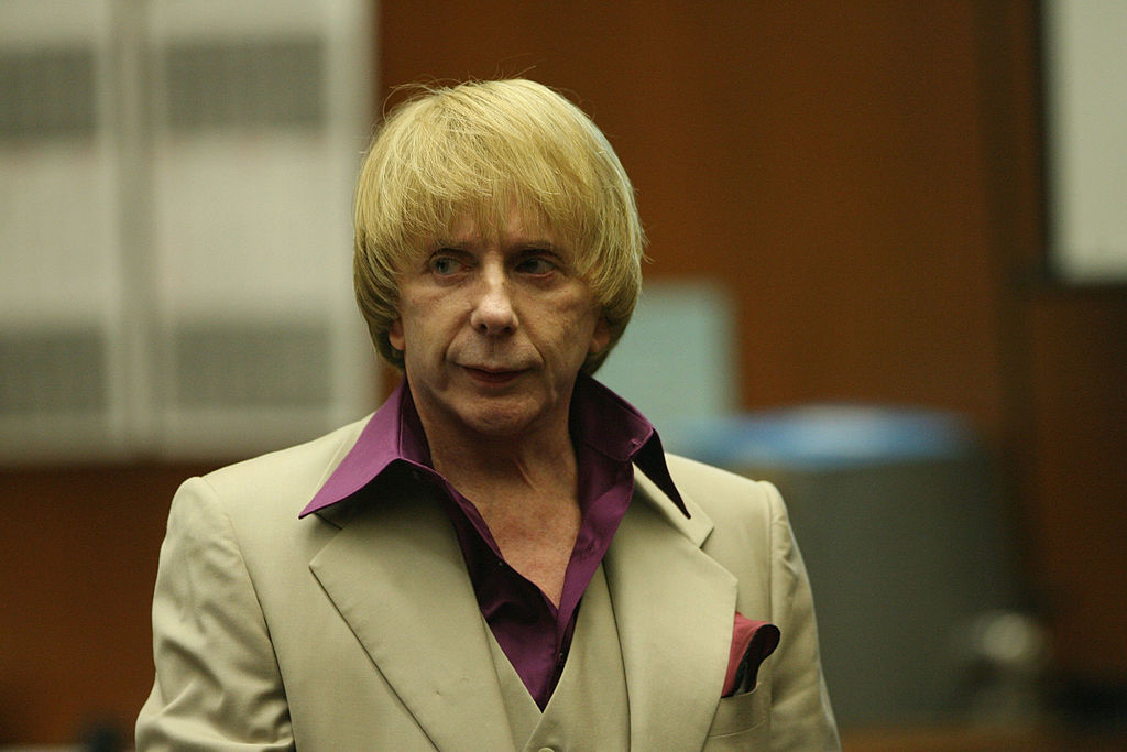 Music producer Phil Spector (R) leaves the courtroom during a break with his lead attorney Bruce Cutler (L) at Los Angeles Superior Court in Los Angeles, California, on April 25, 2007.                                          Photo by Gabriel Bouys-Pool/Getty Images)