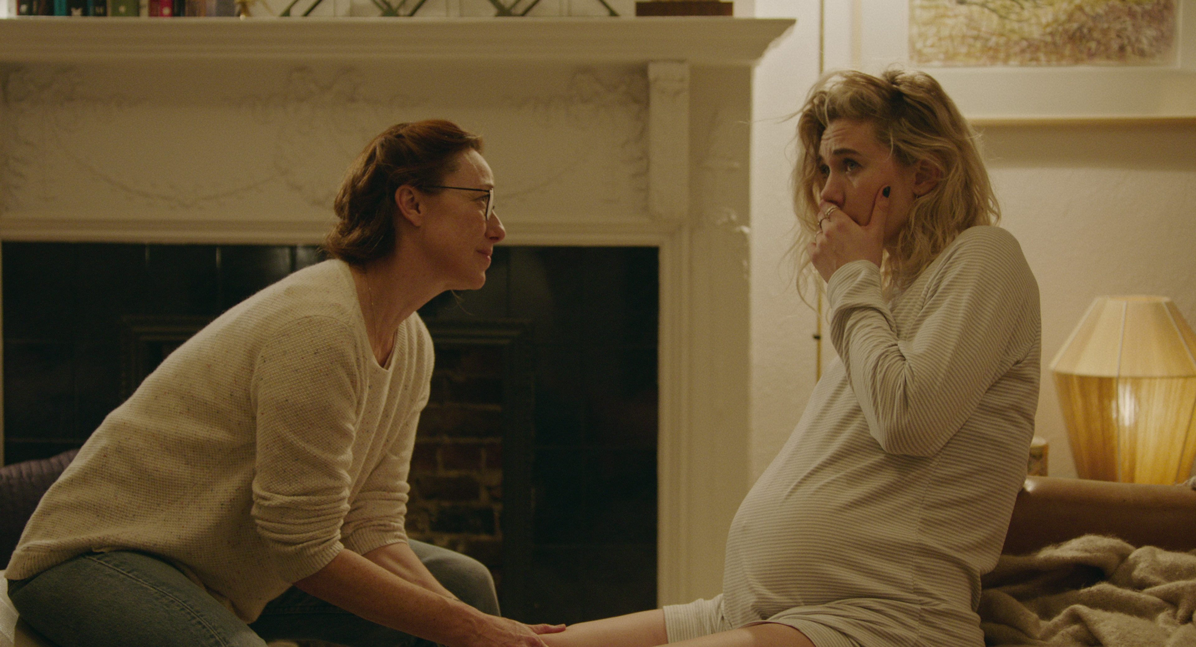 Molly Parker as the midwife Eva helps Vanessa Kirby's Martha through labor