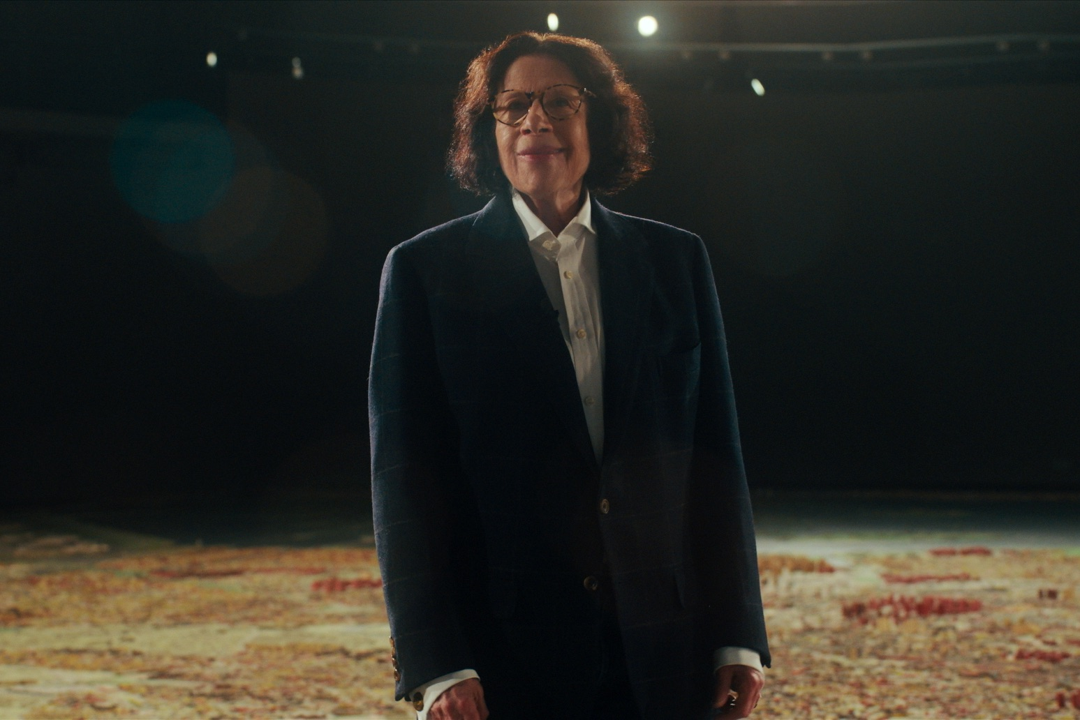 Fran Lebowitz stands above the Queens Museum's scale model of the five boroughs in 'Pretend It's a City'