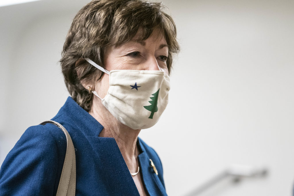 Senator Susan Collins, a Republican from Maine, wears a protective mask while walking through the Senate Subway at the U.S. Capitol in Washington, D.C., U.S., on Jan. 28, 2021.