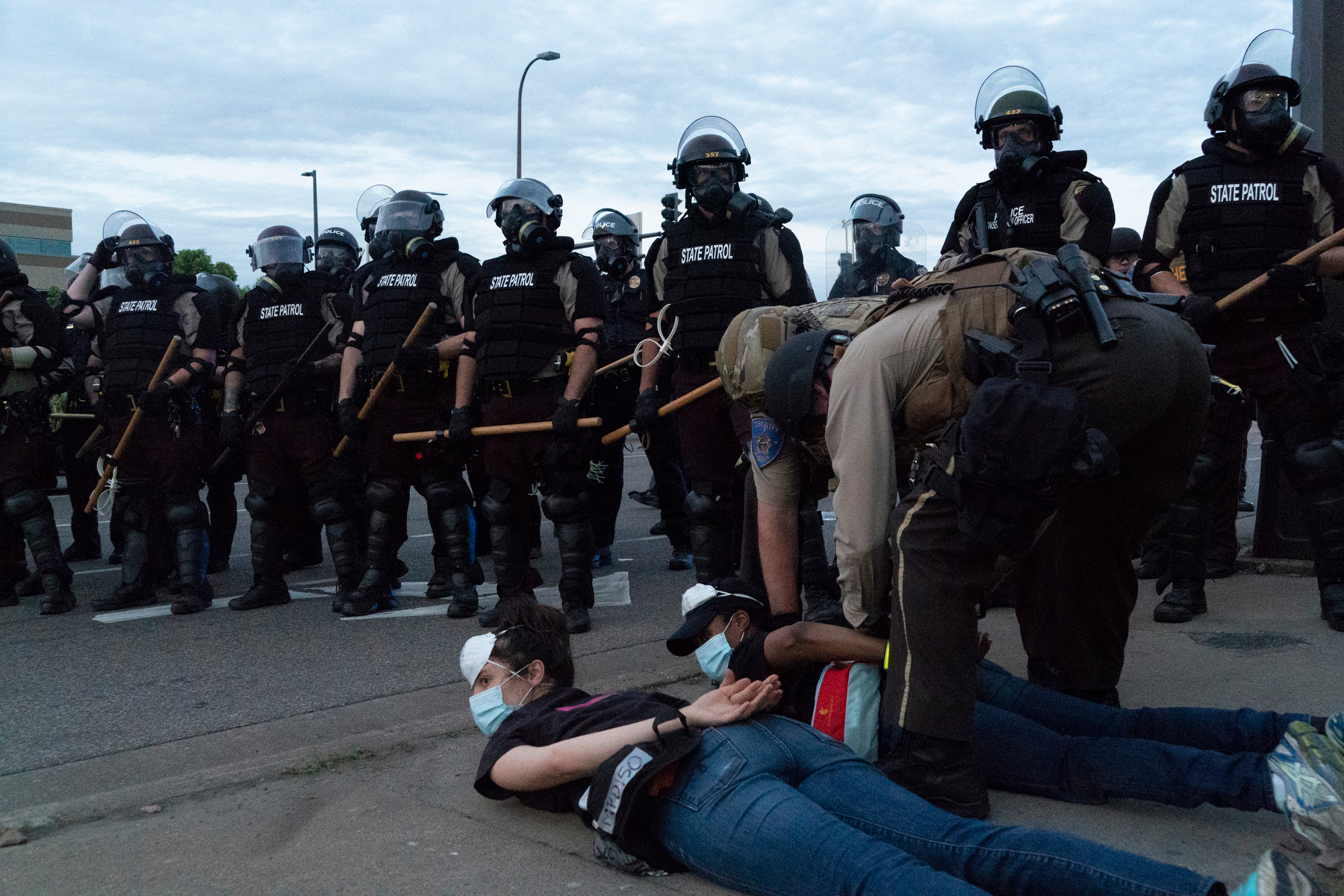 "Minneapolis, May 31, 2020. Police ""kettle"" and arrest a group of several hundred people protesting the killing of George Floyd after curfew."