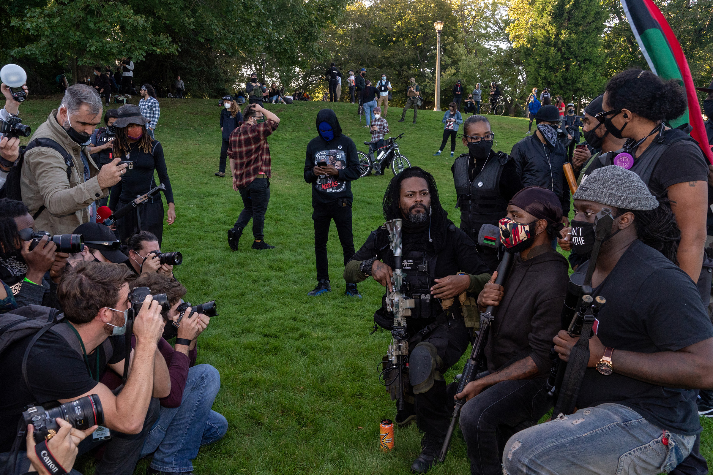 Portland, Ore., Sept. 26, 2020.  Militia members pose for the media at a Black Lives Matter protest. On the same day, in a nearby park, a Black Lives Matter rally dissolved into infighting. The situation was deescalated by this Black militia, which posed for photos.