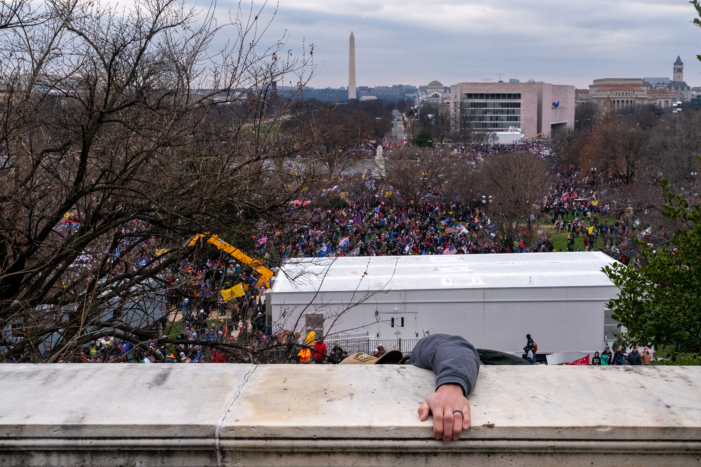 A rioter climbs the walls of the U.S. Capitol after President Trump encouraged a rally audience to pressure Republican lawmakers on Jan. 6.