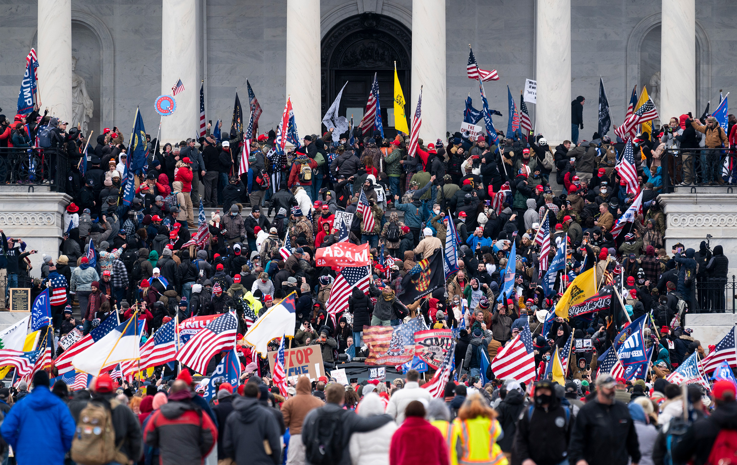 Trump supporters take over the steps of the U.S. Capitol as the Congress works to certify the electoral college votes on Jan. 6, 2021.