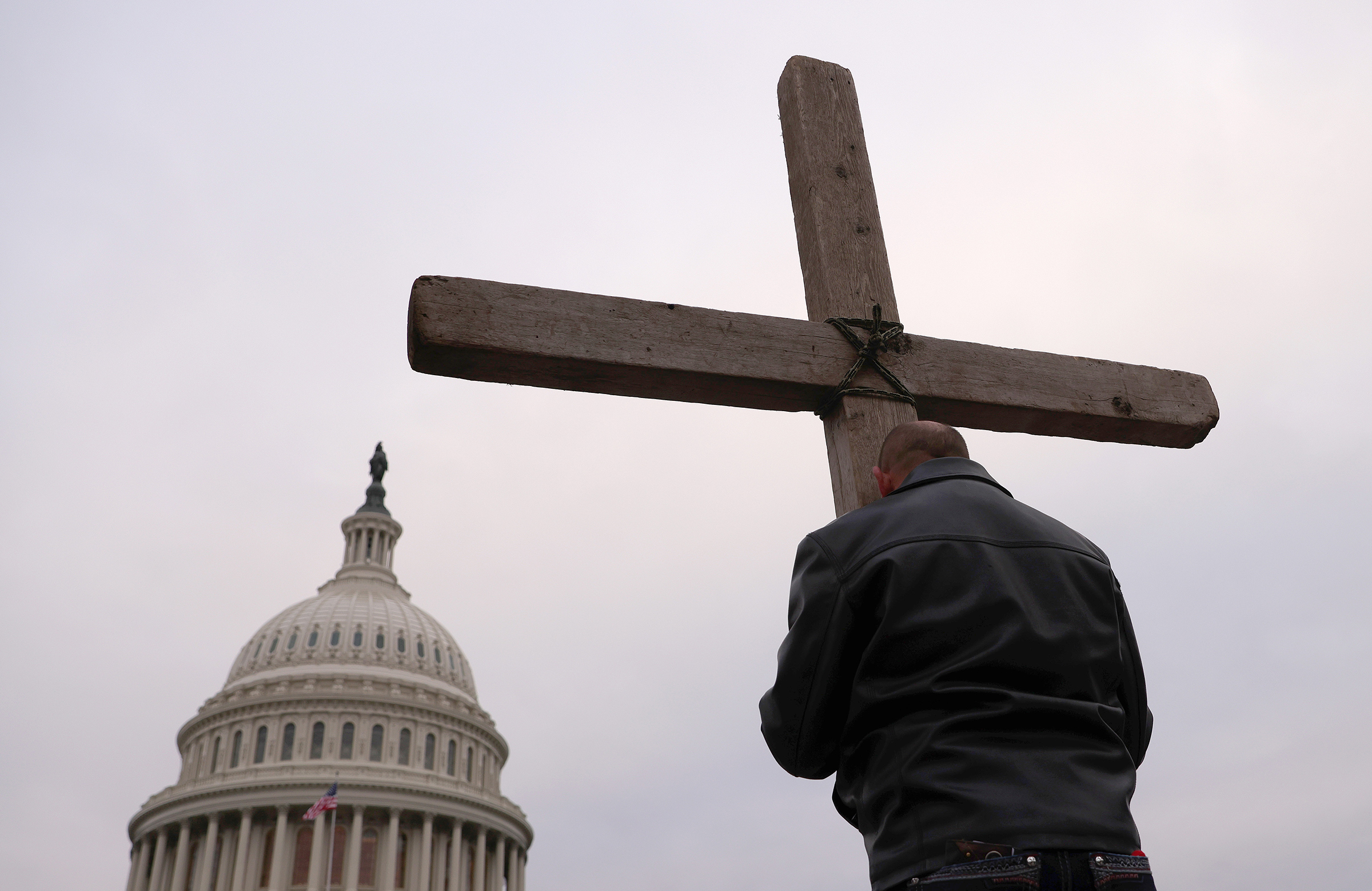 Supporters of U.S. President Donald Trump pray outside the U.S. Capitol Jan. 06 in Washington D.C.