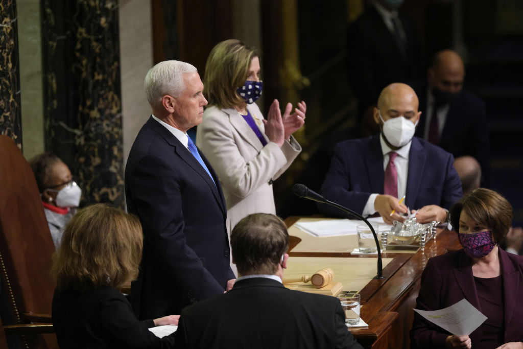 Vice President Mike Pence and Speaker of the House Nancy Pelosi (D-CA) look on during the the count of electoral votes continues in the House Chamber during a reconvening of a joint session of Congress on Jan. 7, 2021 in Washington, D.C.