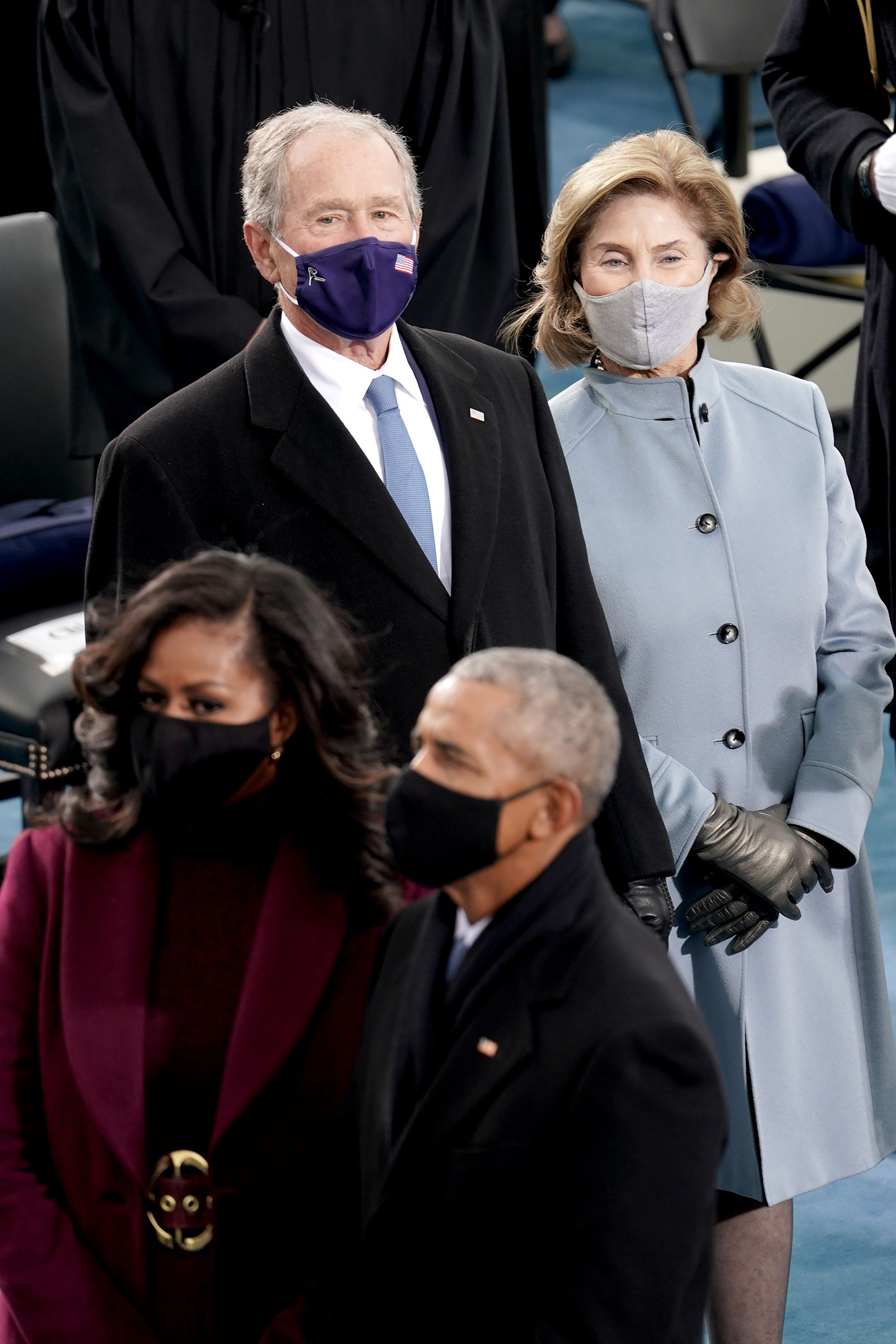 Former President George W. Bush, Laura Bush, former President Barack Obama and Michelle Obama are seen prior to the 59th Presidential Inauguration.