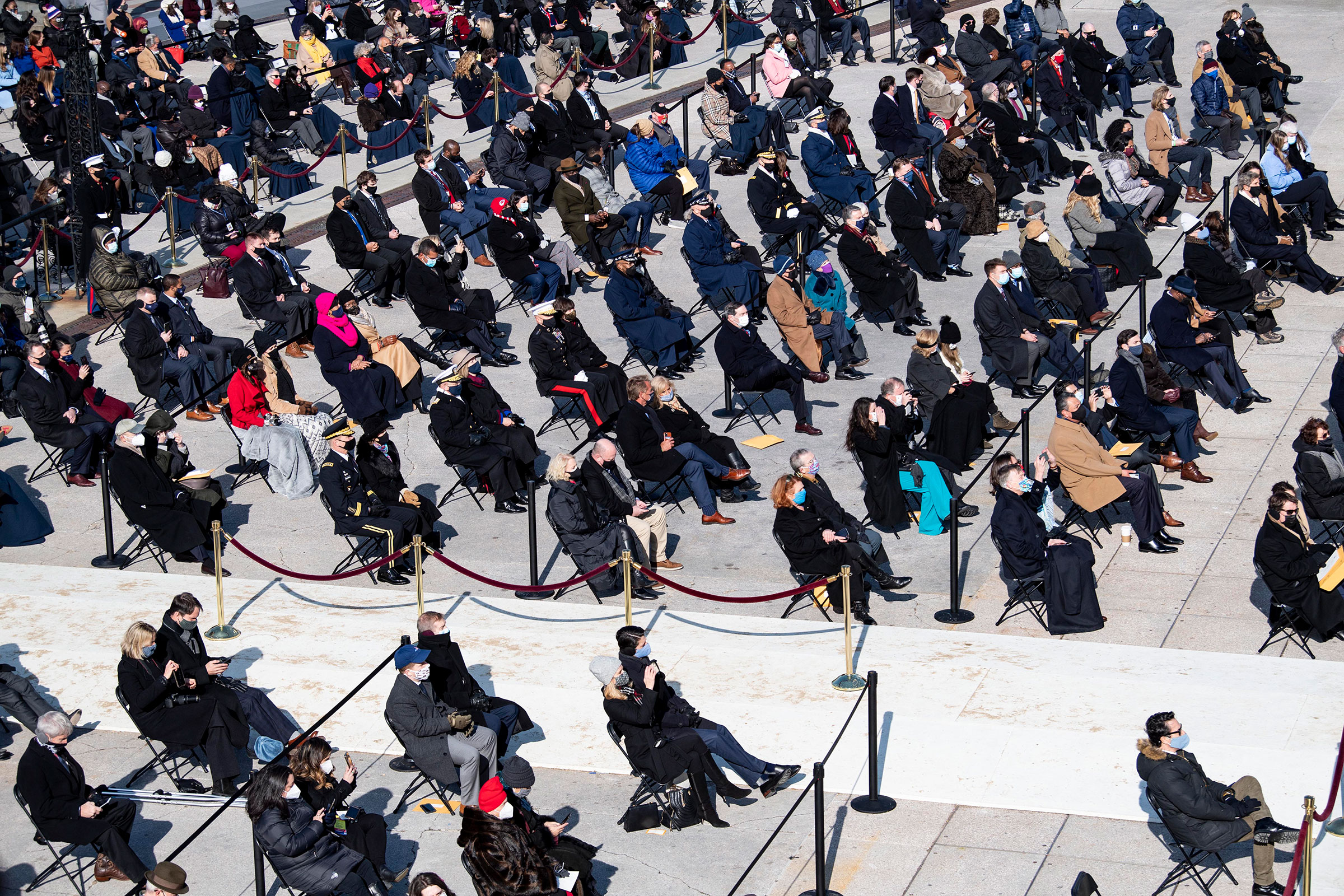A social distanced crowd, looks on for the inaugural ceremony.