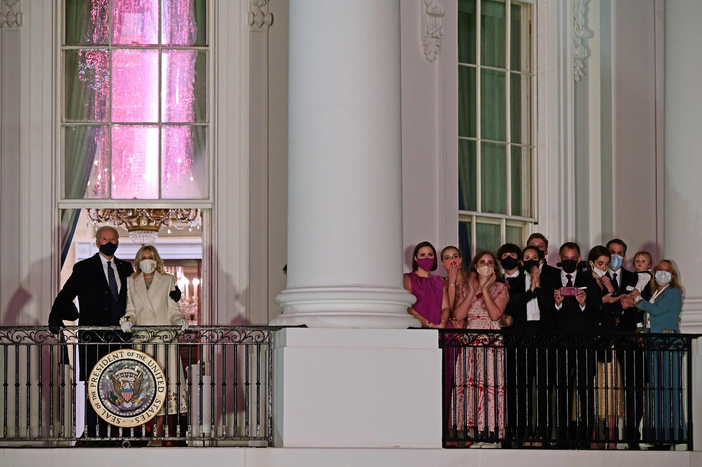 President Joe Biden, First Lady Dr. Jill Biden and family watch fireworks from the Blue Room Balcony of the White House.