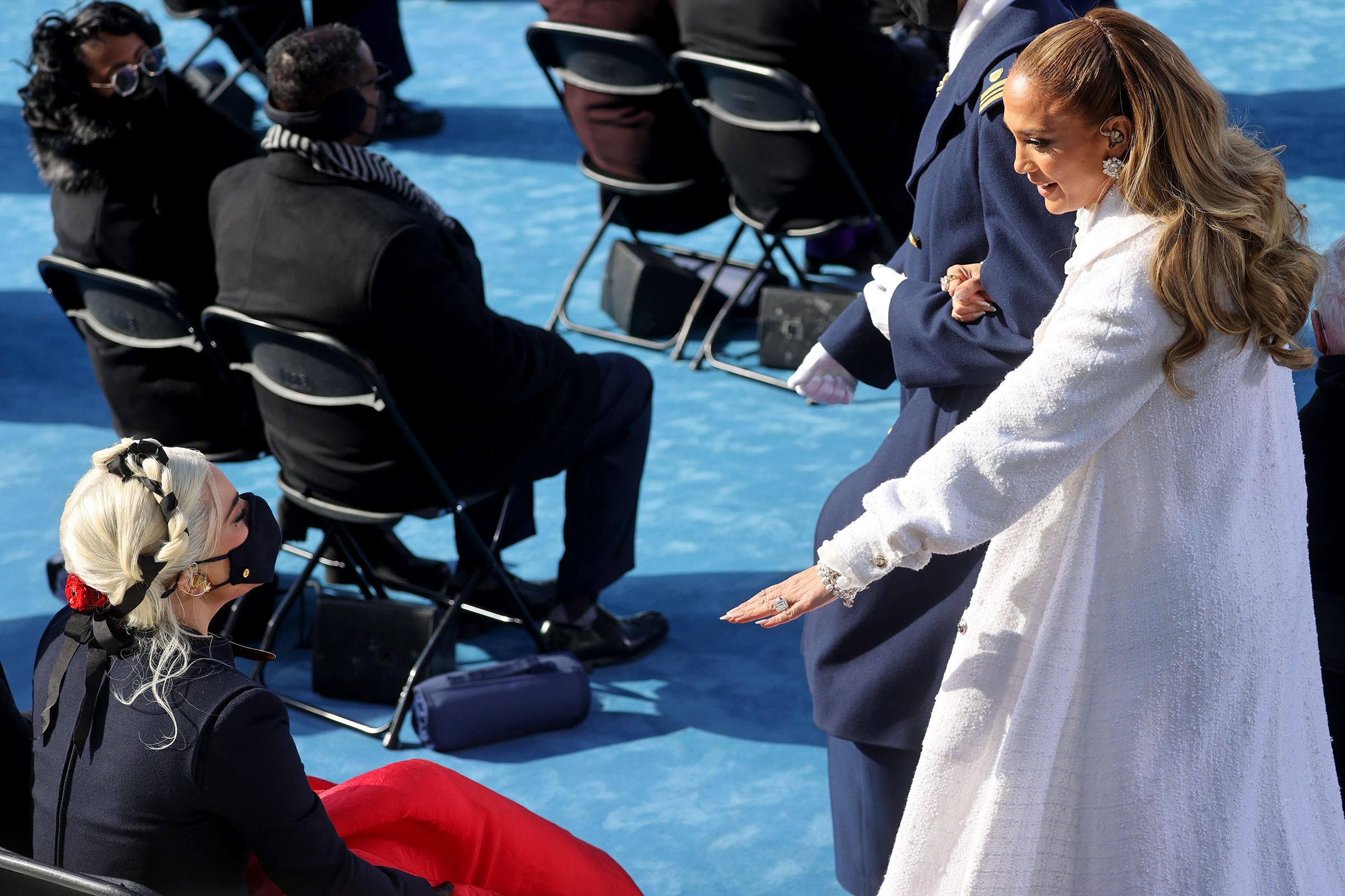 Jennifer Lopez, right, greets Lady Gaga during the 59th presidential inauguration.