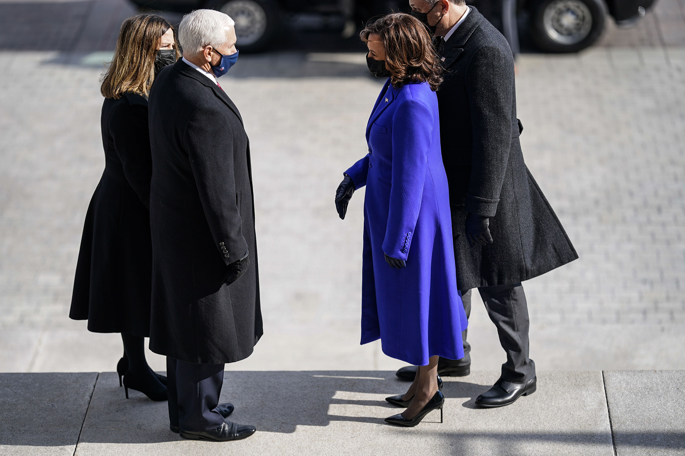 Former Vice President Mike Pence and his wife, Karen Pence speak with Vice President Kamala Harris and Doug Emhoff, after the inauguration.