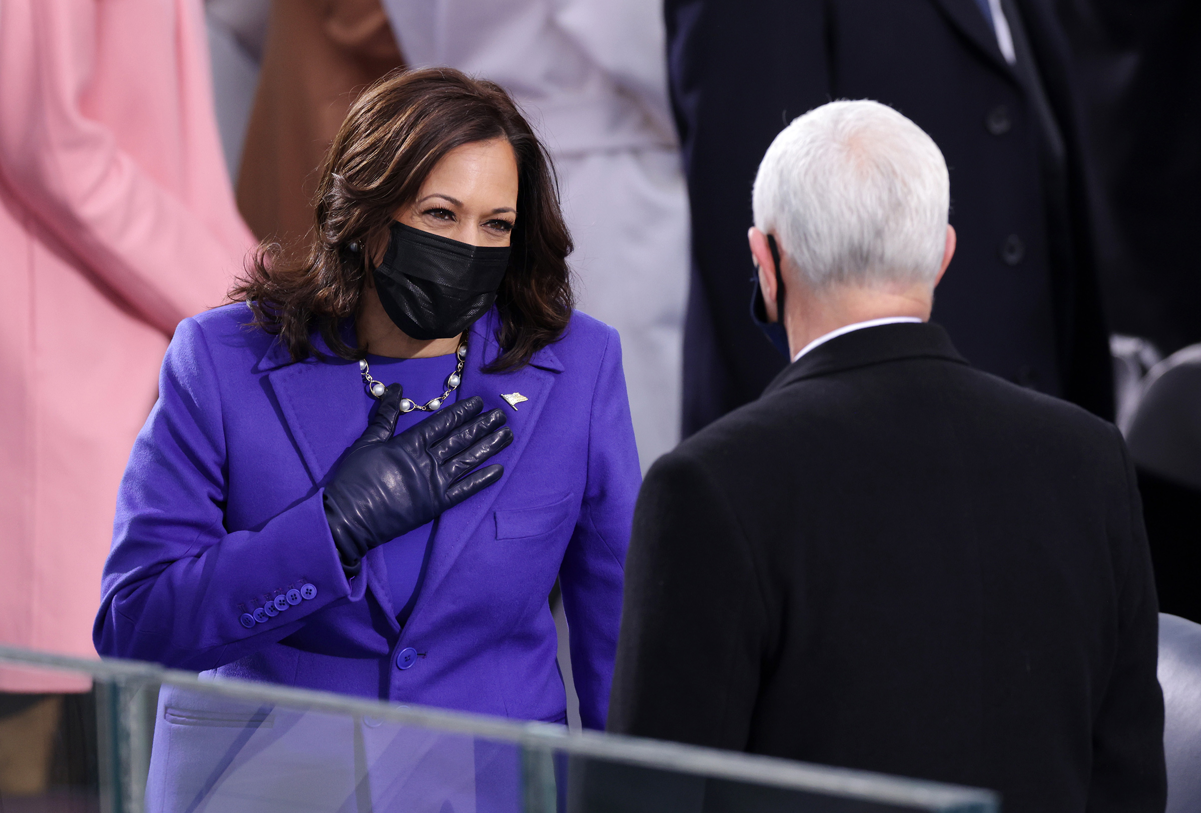 Vice President-elect Kamala Harris greets Vice President Mike Pence as she arrives to the inauguration on the West Front of the U.S. Capitol.