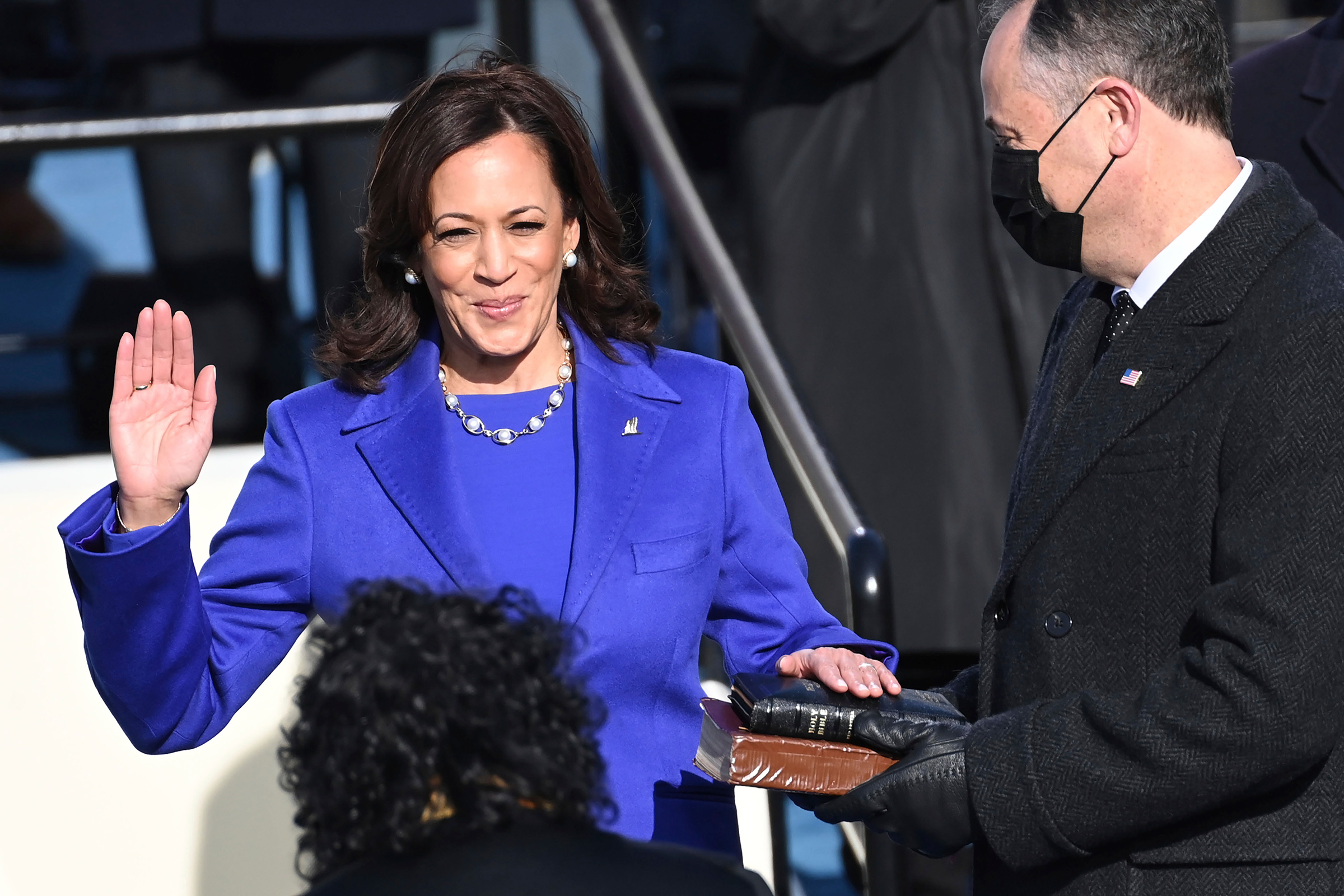 Kamala Harris is sworn in as vice president by Supreme Court Justice Sonia Sotomayor as her husband Doug Emhoff holds the Bible.