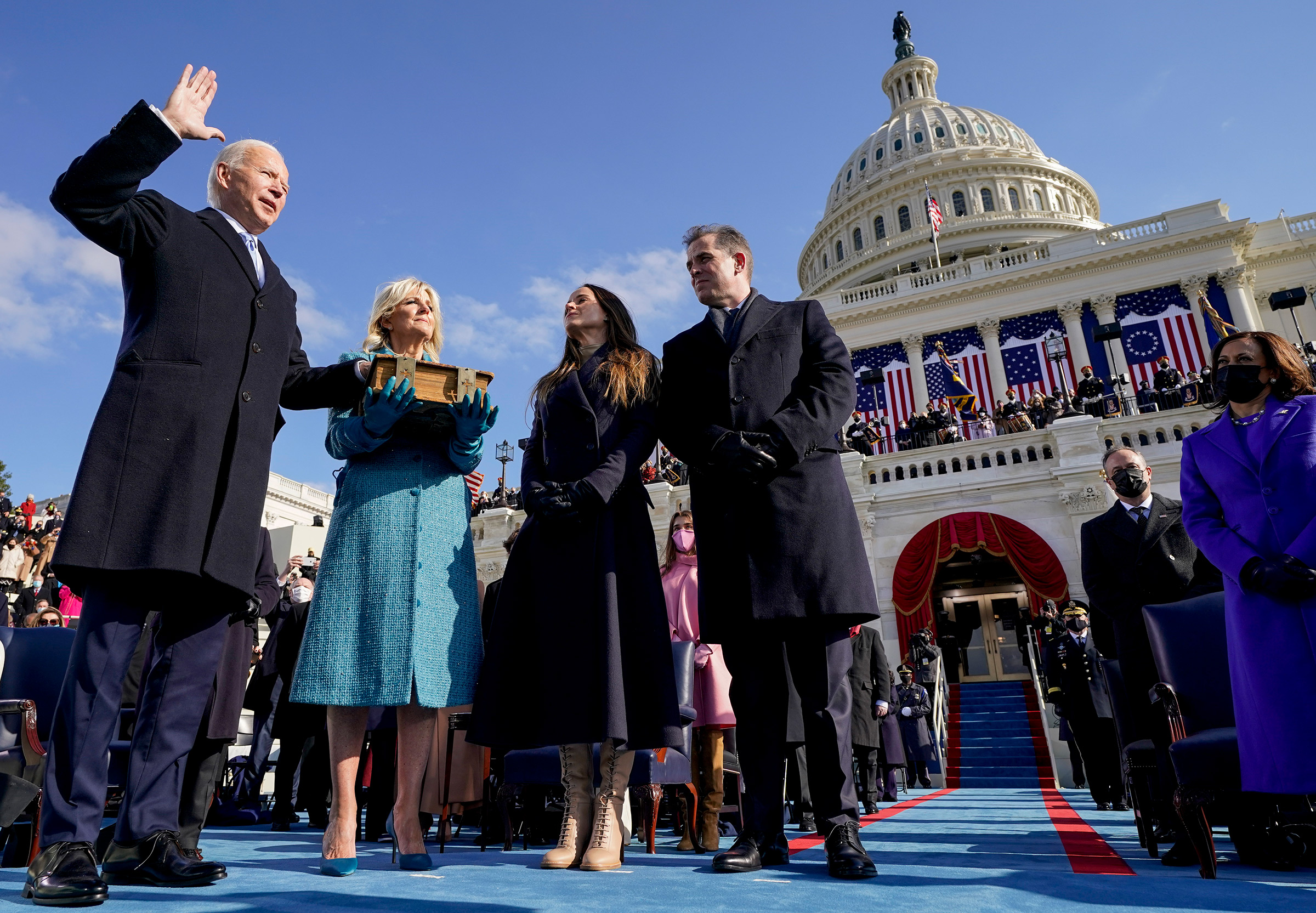 Joe Biden is sworn in as the 46th president of the United States by Chief Justice John Roberts as Jill Biden holds the Bible.