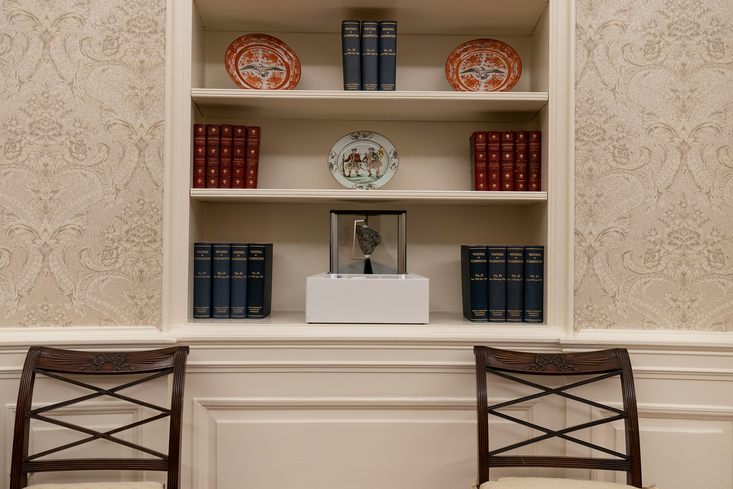 President Joe Biden's redecoration of the Oval Office of the White House includes a rock from the moon, shown here on the bottom shelf on Jan. 20, 2021.